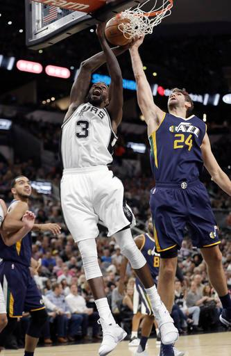 San Antonio Spurs center Dewayne Dedmon (3) drives to the basket past Utah Jazz center Jeff Withey (24) during the first half of an NBA basketball game, Tuesday, Nov. 1, 2016, in San Antonio. (AP Photo/Eric Gay)