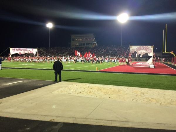 Hewitt-Trussville football players run onto the field to play its first-ever game at the new Huskies Stadium, Friday, Oct. 24, 2014.