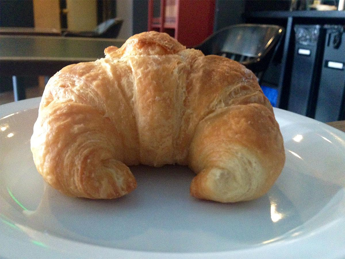 Huge and dark, this croissant will leave you fully satisfied. (Image: Jenny Kuglin / Seattle Refined)