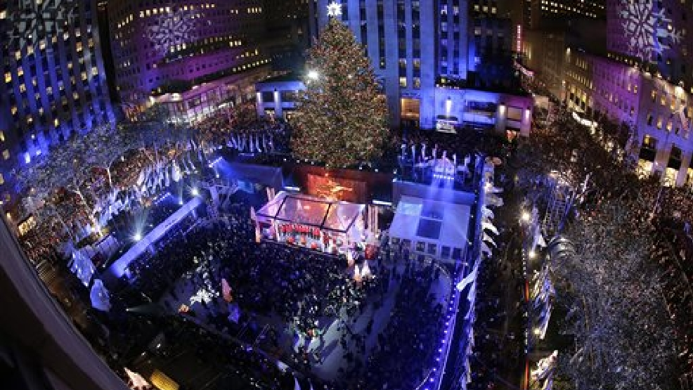 People watch as the Rockefeller Center Christmas tree is lit during a ceremony on Wednesday Dec. 2 2015 in New York. The Norway Spruce tree stands at ... & Heightened security amid Rockefeller Christmas Tree lighting | WLUK