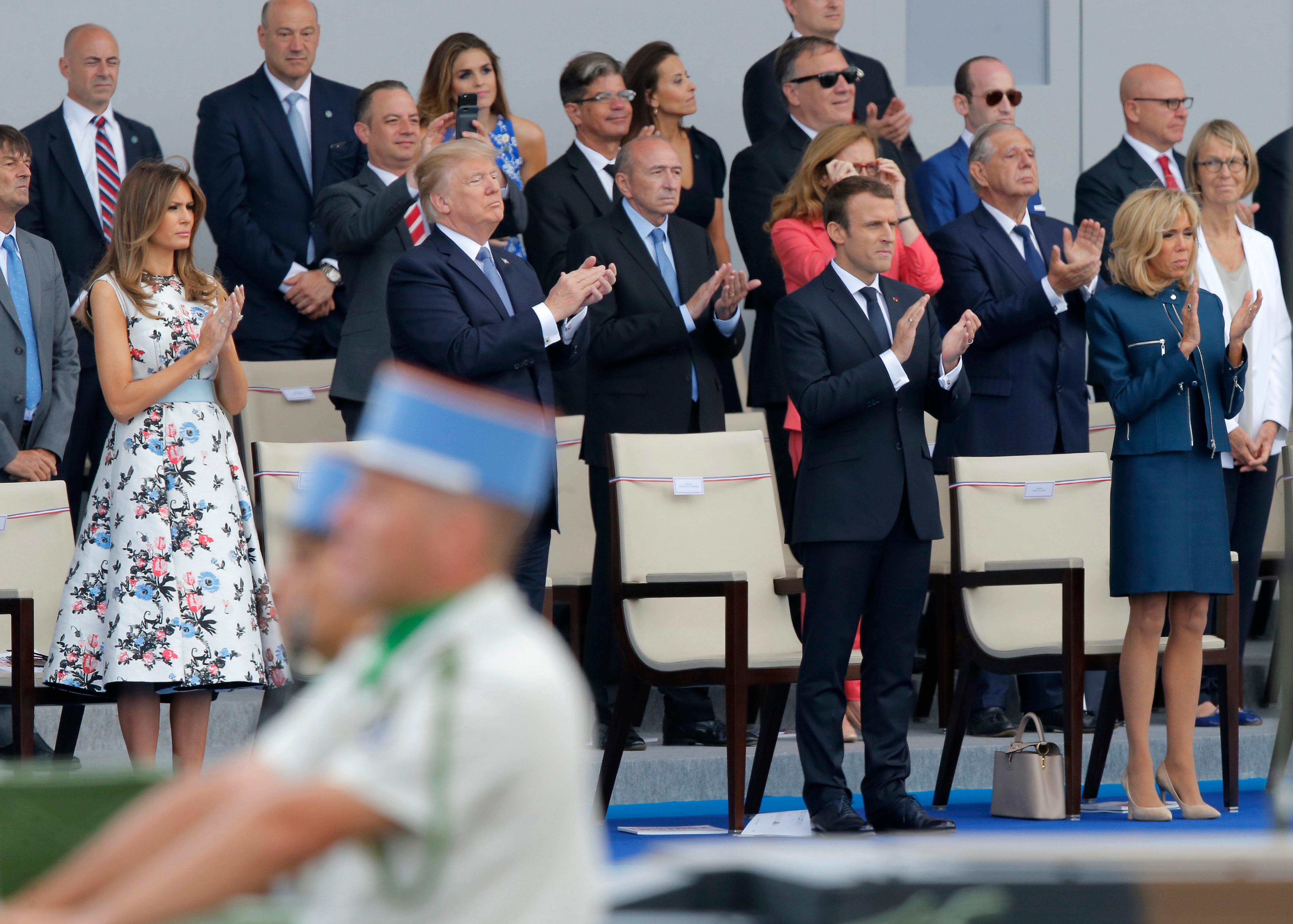 U.S. President Donald Trump, French President Emmanuel Macron, 2nd right, his wife, Brigitte Macron, right, and U.S. First Lady Melania Trump, left, applaud as they watch the traditional Bastille Day military parade on the Champs Elysees, in Paris, Friday, July 14, 2017. (AP Photo/Michel Euler)