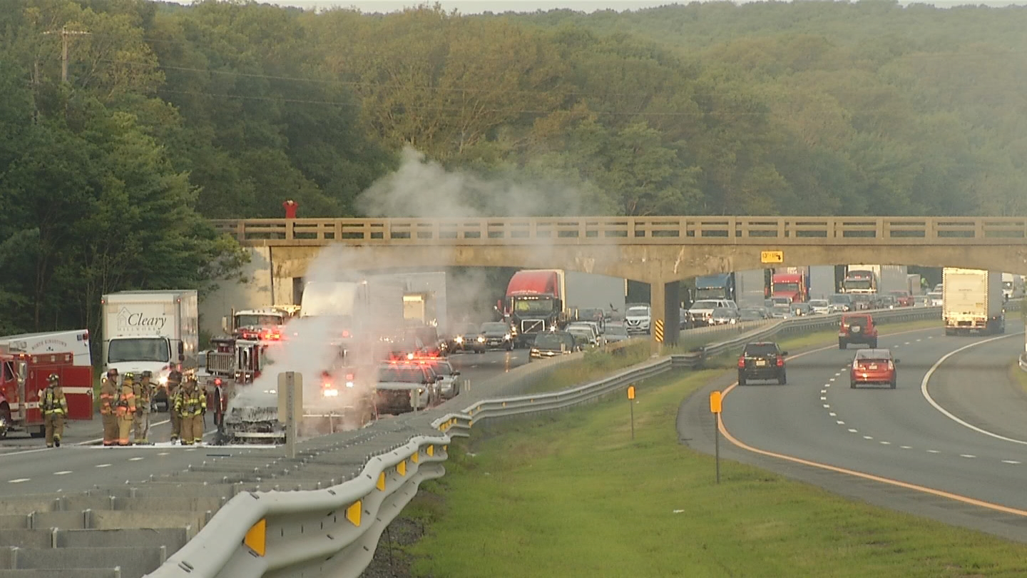 A car catches fire on Interstate 95 near exit 7 in East Greenwich, Monday, Aug. 7, 2017. (WJAR)