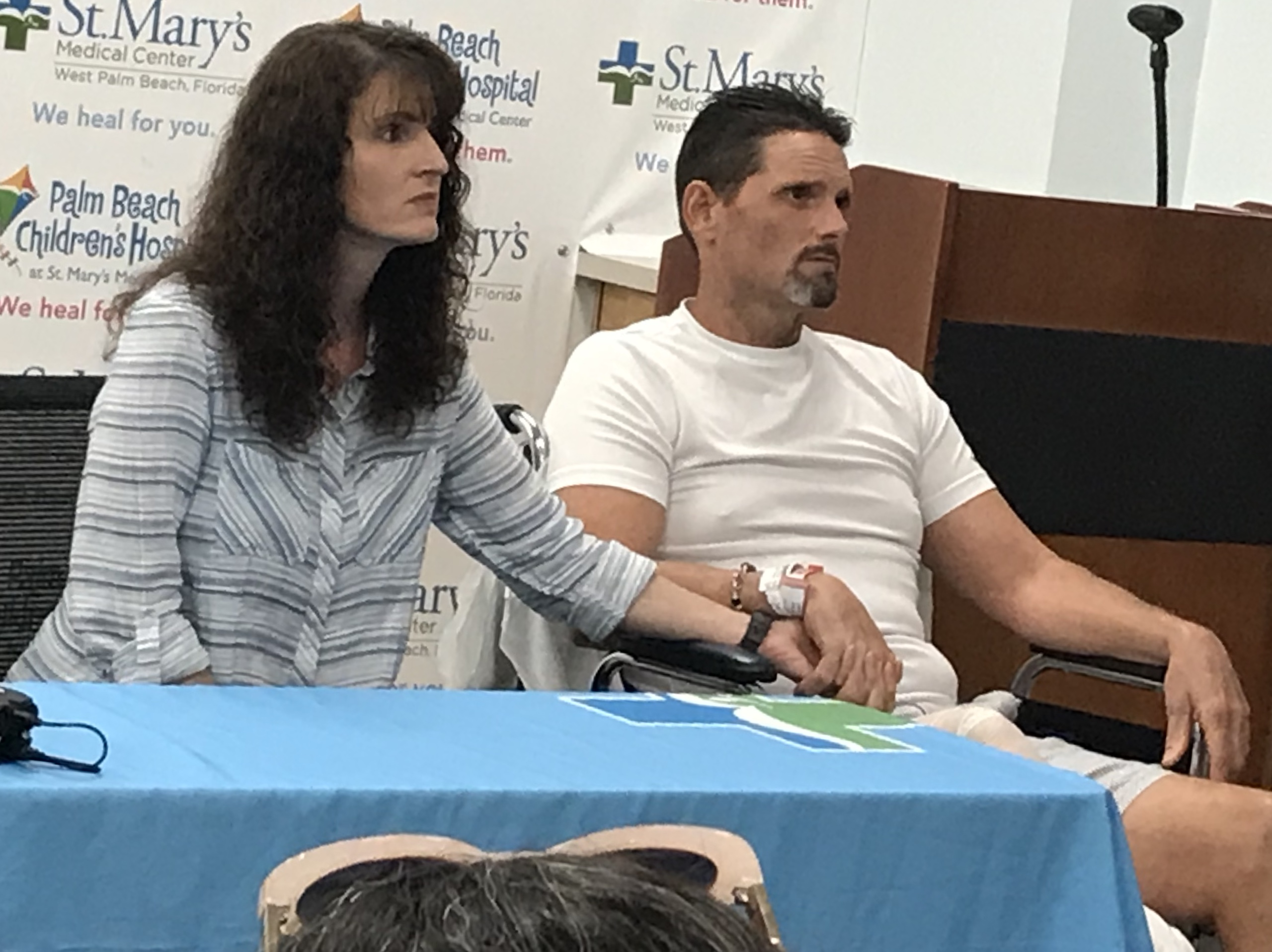 Hunter James Boyce shares his story of survival. His wife, Terisa, sits next to him at St. Mary's Medical Center. (WPEC)