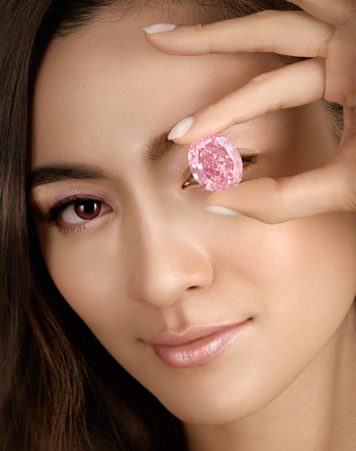"A stunning 59.6 carat diamond known as the ""Pink Star"" sold for $71.2 million at a Sotheby's auction Tuesday in Hong Kong, setting a new world record for any diamond or jewel, according to the auction house. (Sotheby's)"