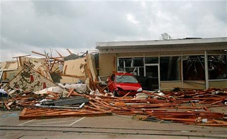 A building is damaged in Tupelo, Miss. Monday, April 28, 2014.