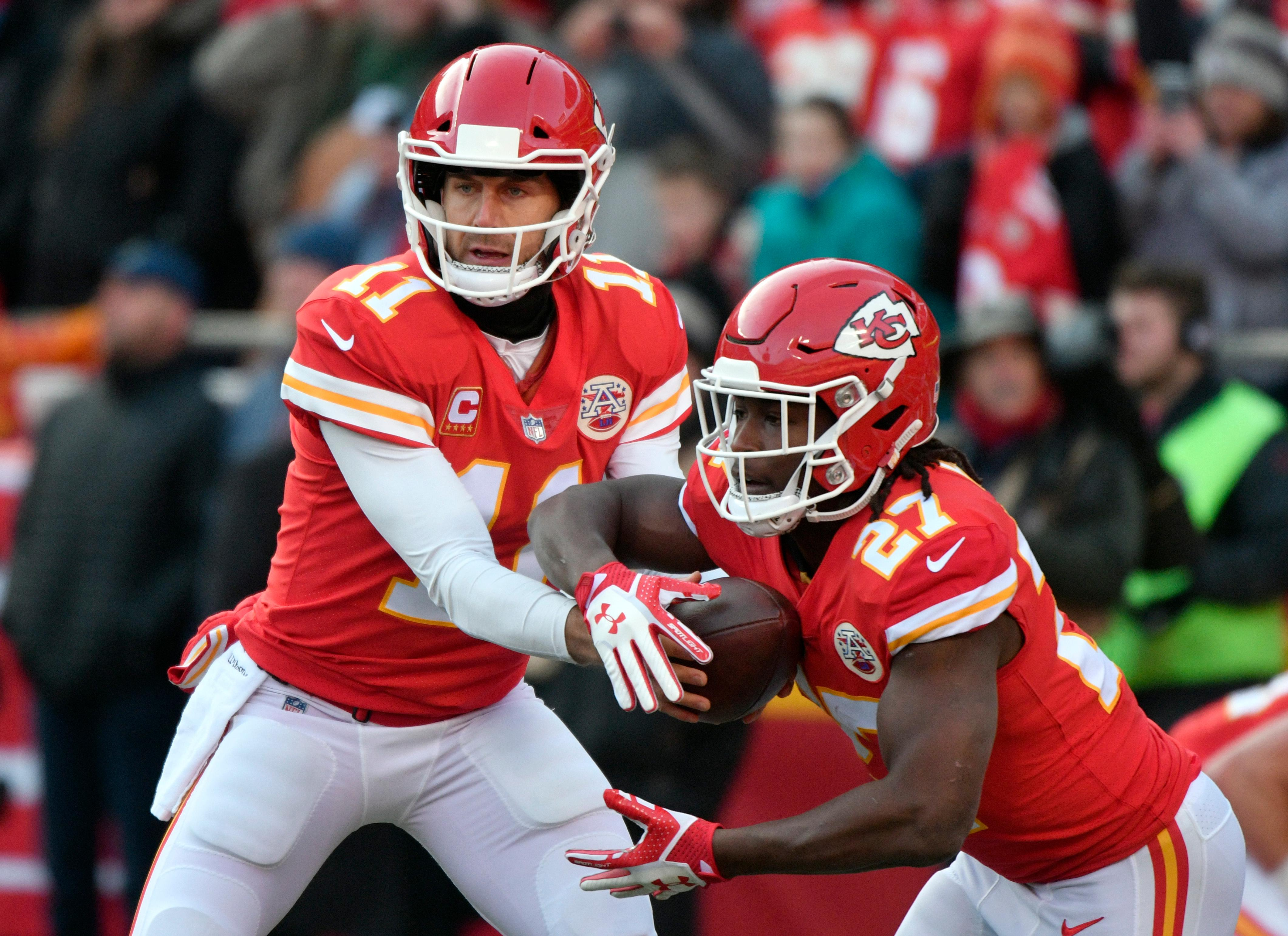 Kansas City Chiefs quarterback Alex Smith (11) hands the ball off to running back Kareem Hunt (27) during warmups before an NFL wild-card playoff football game against the Tennessee Titans, in Kansas City, Mo., Saturday, Jan. 6, 2018. (AP Photo/Ed Zurga)