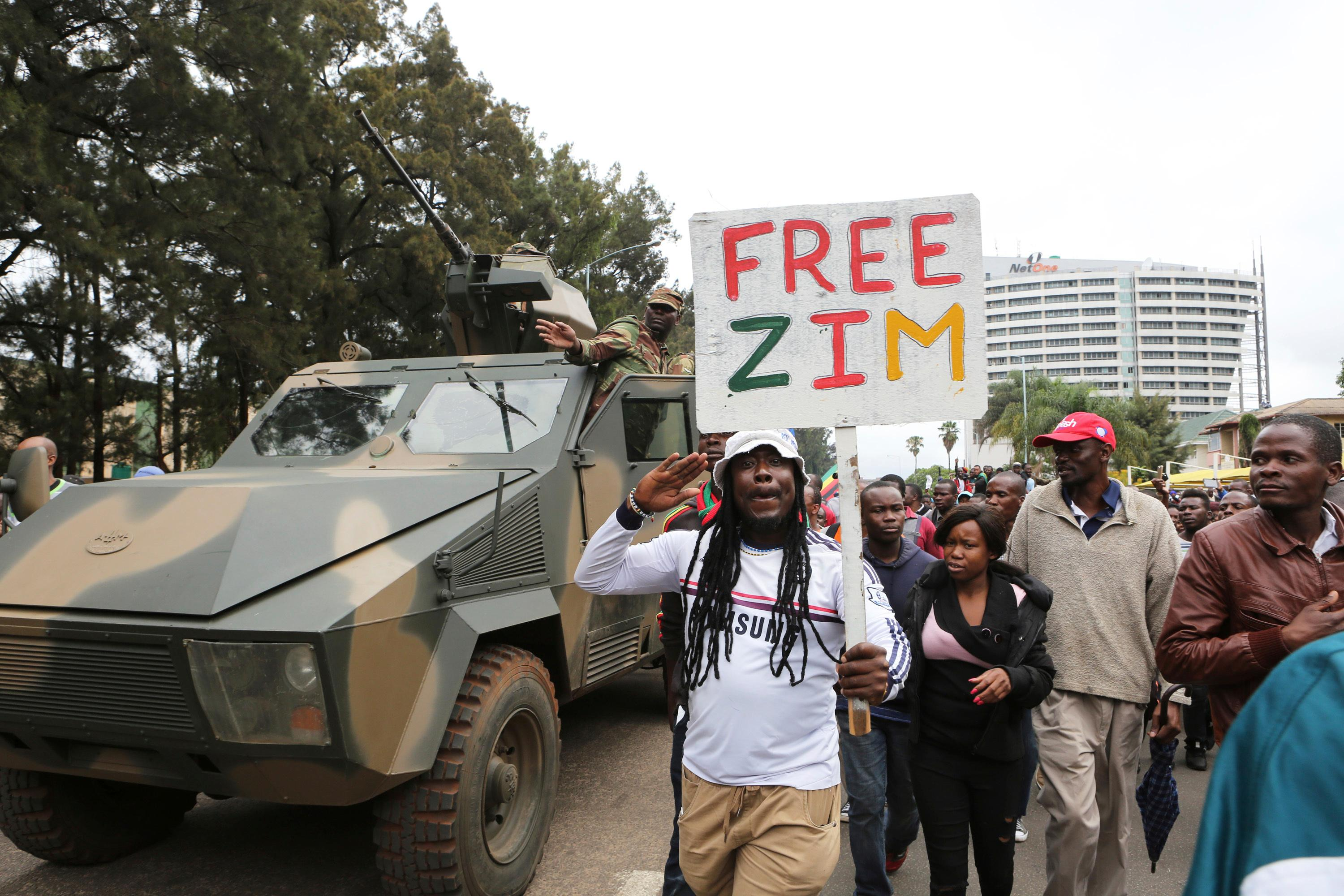 Euphoric crowds march on the streets of Harare, demanding the departure of President Robert Mugabe, Saturday Nov, 18, 2017. The military, which put Mugabe under house arrest this week, has approved the demonstration that includes people from across the political spectrum. (AP Photo/Tsvangirayi Mukwazhi)