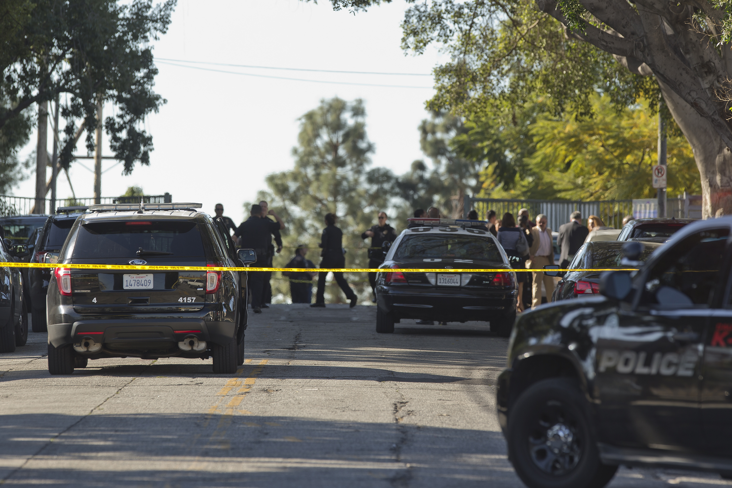 Los Angeles Policecordon off the Belmont High School in Los Angeles Thursday, Feb. 1, 2018. Two students were shot and wounded, one critically, inside a Los Angeles middle school classroom Thursday morning and police arrested a female student suspect, authorities said.  (AP Photo/Damian Dovarganes)