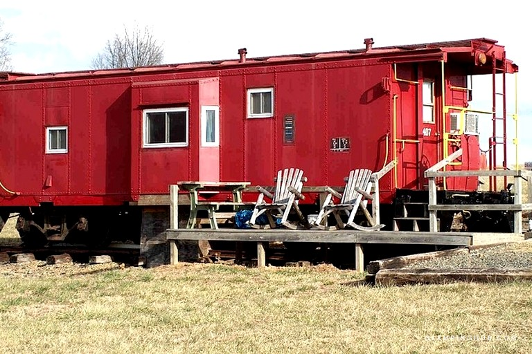 Each caboose, near the Blue Ridge Mountains Virginia,{ } can sleep two guests, come with a fully-furnished bathroom, bedroom and kitchen, two-person Jacuzzi, decks with oversized rockers and charcoal grills. (Image: Courtesy Glamping Hub)