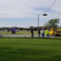 Injured driver cut from vehicle after crash at school