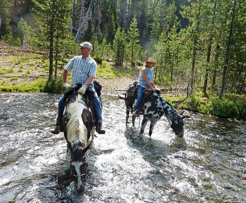 Riders cross a stream at Quinn Meadows Horse Camp. - Photo by Fred West