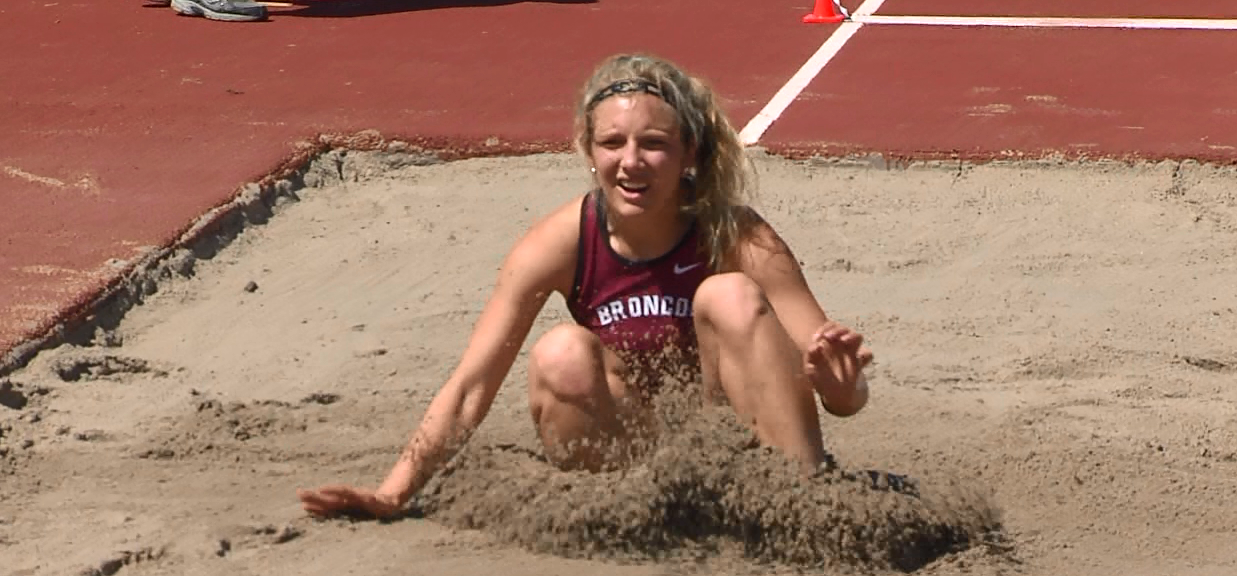 Reganne Markle of Hastings College lands in the pit during the Long Jump.  (NTV News)