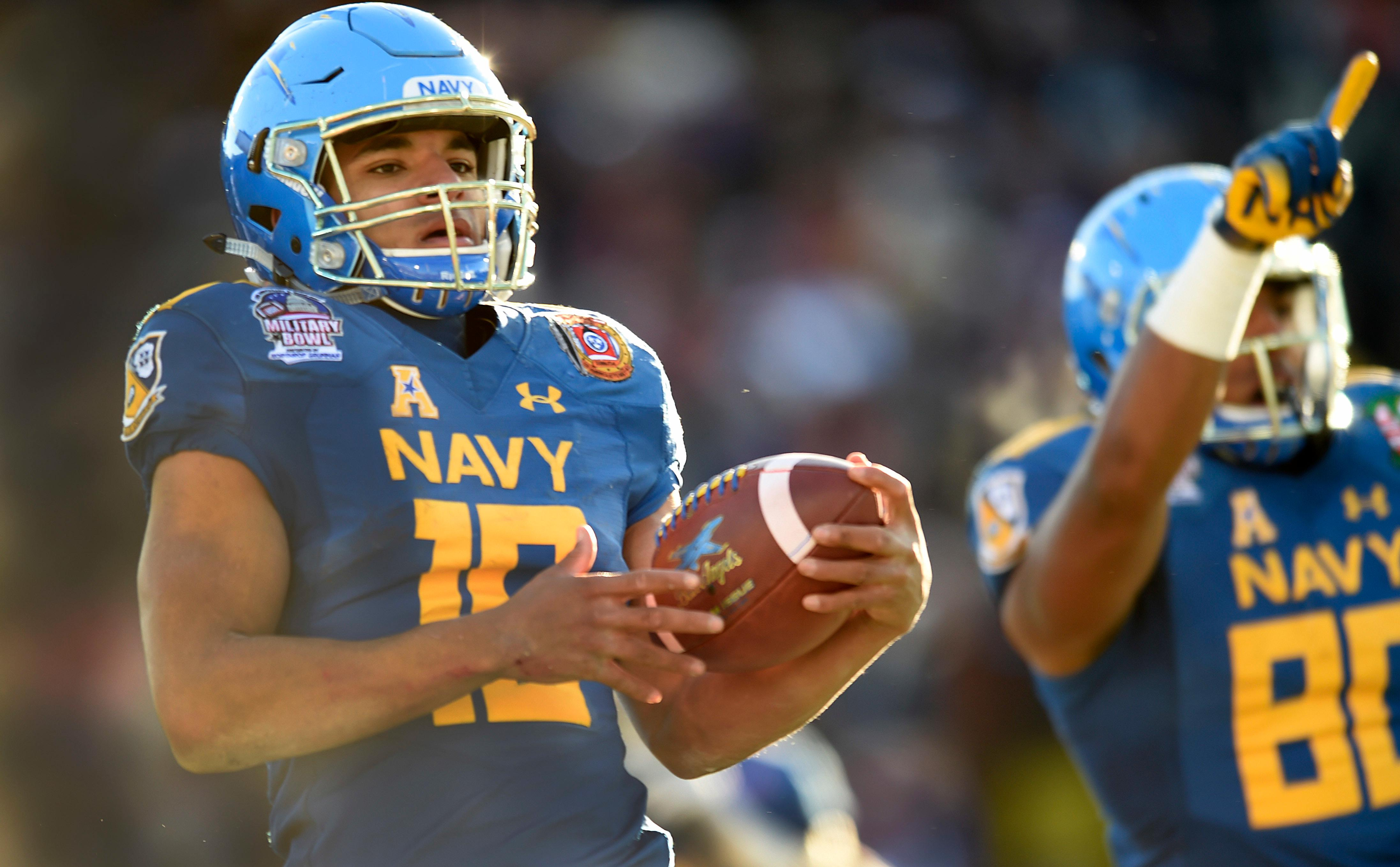 Navy's quarterback Malcolm Perry scores a touchdown against Virginia in the first half of the Military Bowl NCAA college football game, Thursday, Dec. 28, 2017, in Annapolis, Md. (AP Photo/Gail Burton)