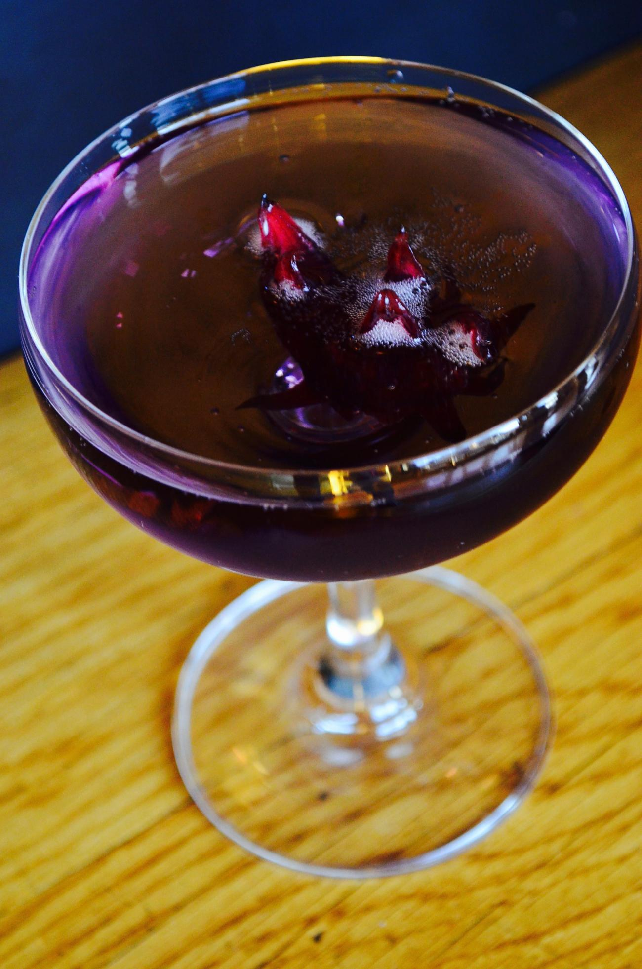 Fleur de Bee - prosecco, violette, St. Germain,  and hibiscus flower / Image: Leah Zipperstein, Cincinnati Refined // Published: 1.2.17