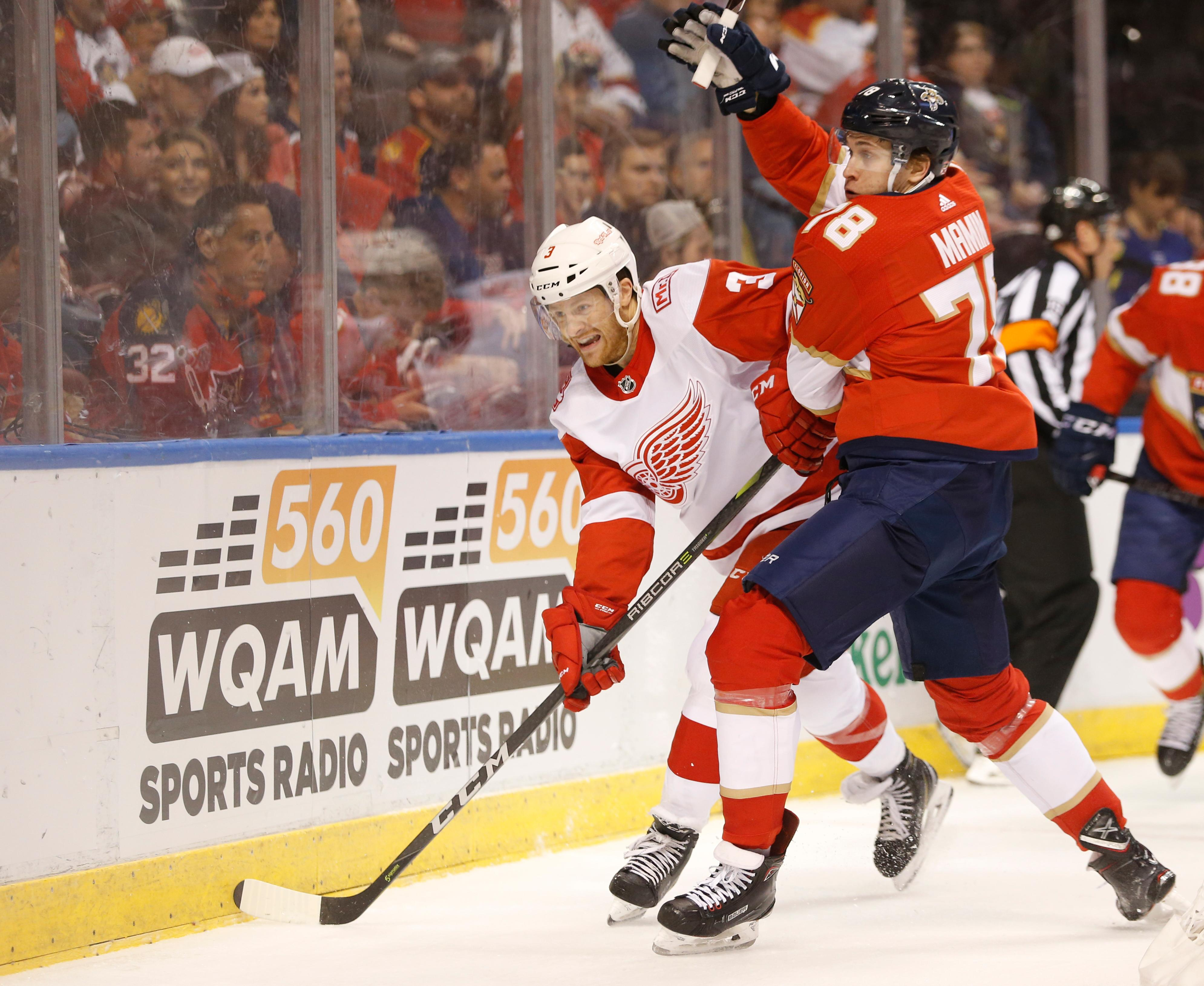 Detroit Red Wings defenseman Nick Jensen (3) and Florida Panthers center Maxim Mamin (78) battle for the puck during the first period of an NHL hockey game, Saturday, Feb. 3, 2018 in Sunrise, Fla. (AP Photo/Wilfredo Lee)