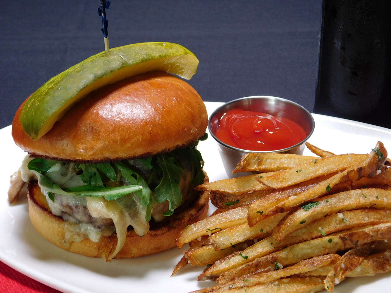FIRE's Umami Burger: swiss cheese, caramelized bourbon mushroom, onion, truffle mayo, and arugula on a brioche bun{ }/ Image courtesy of RiverCenter Entertainment // Published: 6.20.19