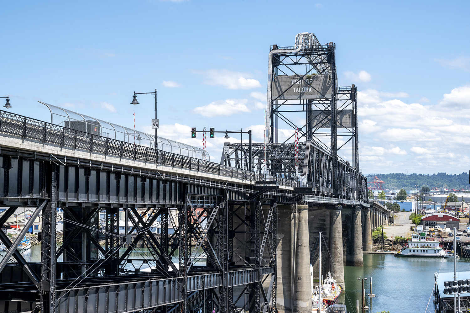 Opened in 1911, the Murray Morgan Bridge, also known as the 11th Street Bridge, is a vertical-lift bridge and considered a Tacoma, Washington icon. This unique type of lift bridge rises vertically while remaining parallel with the deck. (Image: Rachael Jones / Seattle Refined)