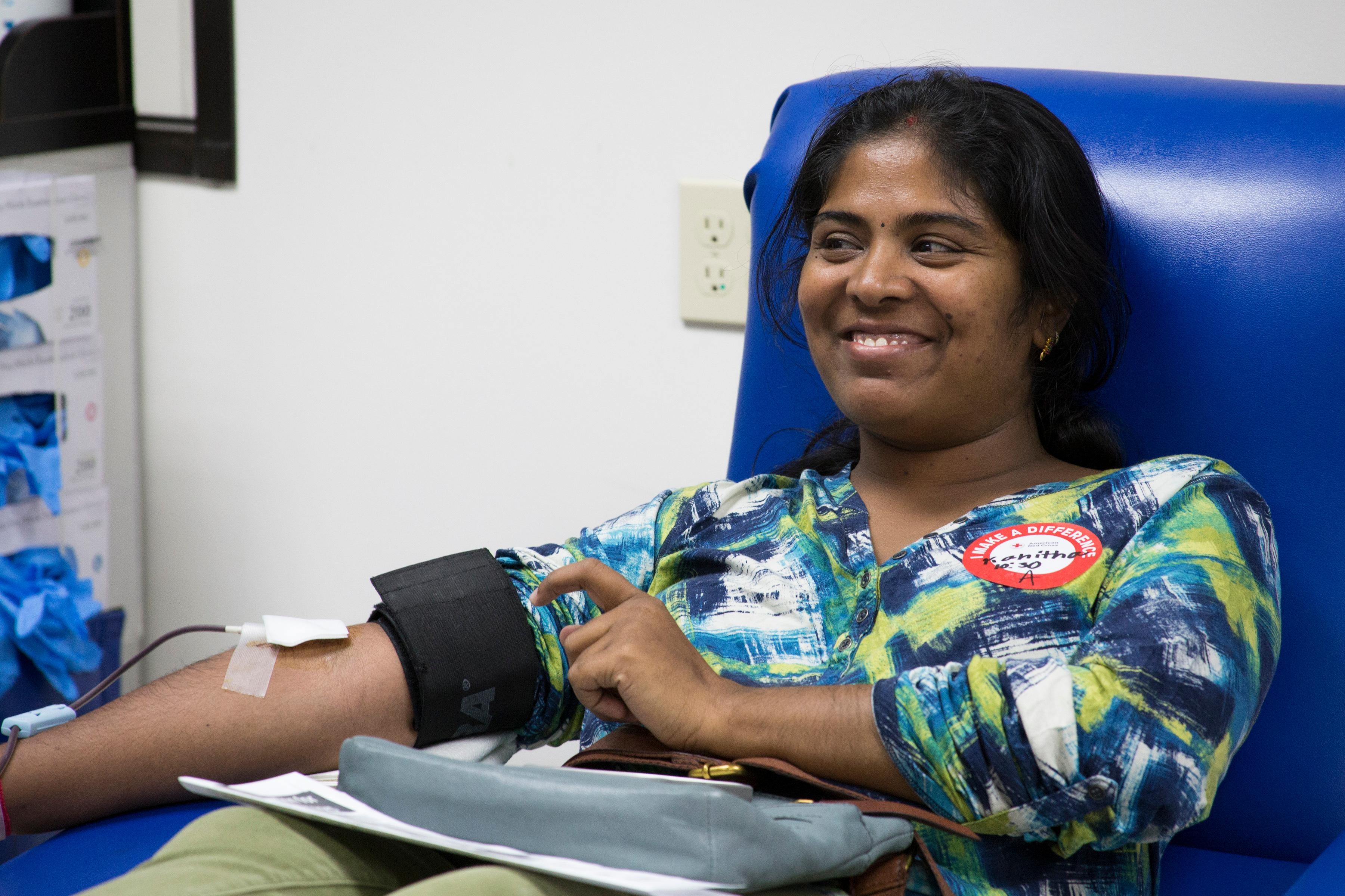 Kavitha Gadiraju gives a whole blood donation at the Charlotte Donor Center.