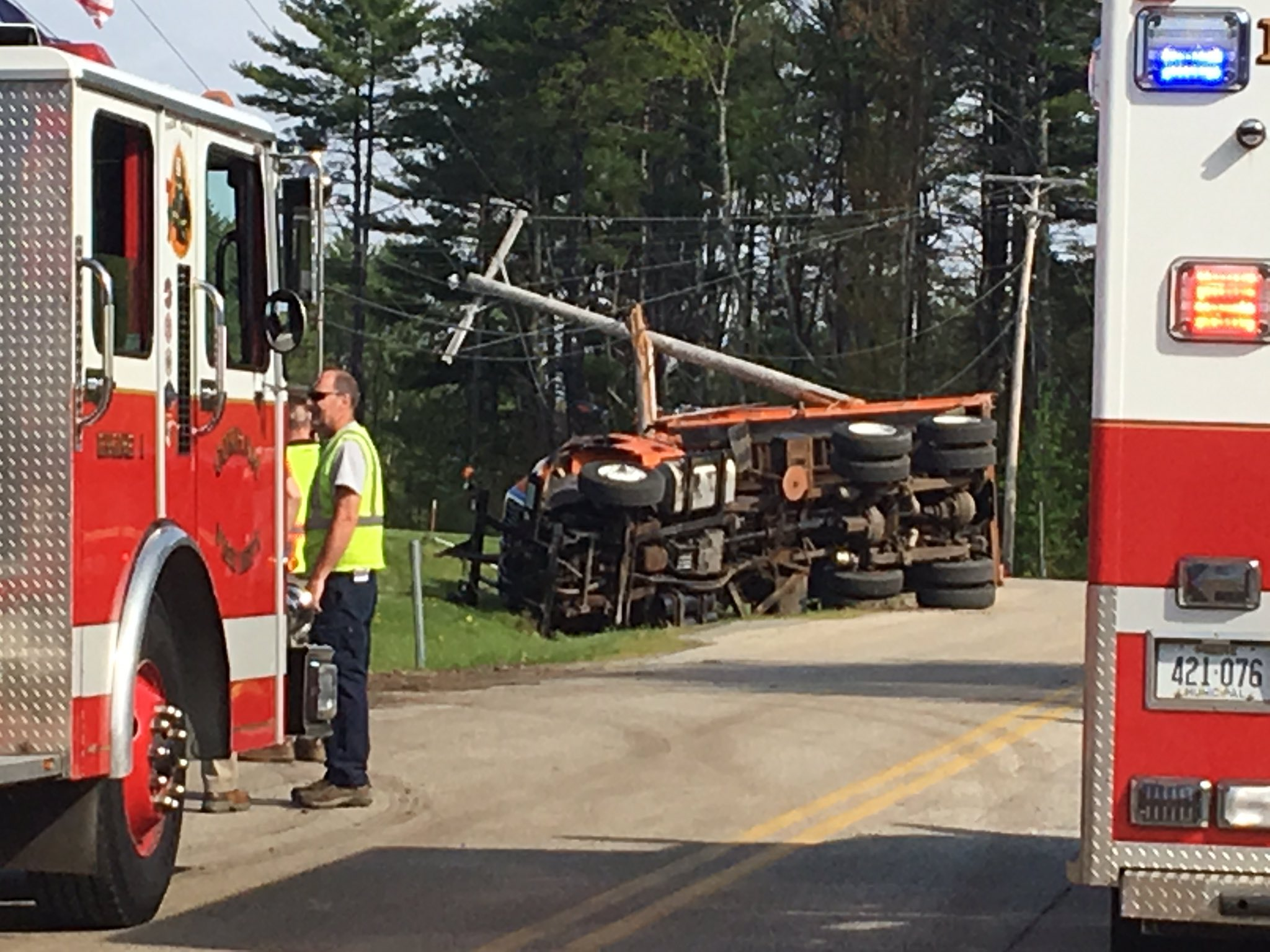 Police say a dump truck has crashed in Gorham, taking out a telephone police and trapping the driver inside. (WGME)