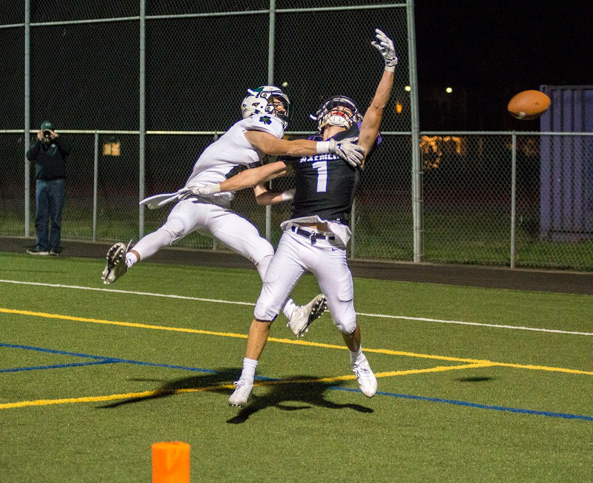 Eugene Axemen Elliot James (#1) attempts to catch the pass in the endzone but is blocked by Sheldon Irish defense. Sheldon Irish defeated South Eugene Axemen 63-6 on Friday night at South Eugene Highschool in Eugene, Ore. Photo by Rhianna Gelhart, Oregon News Lab