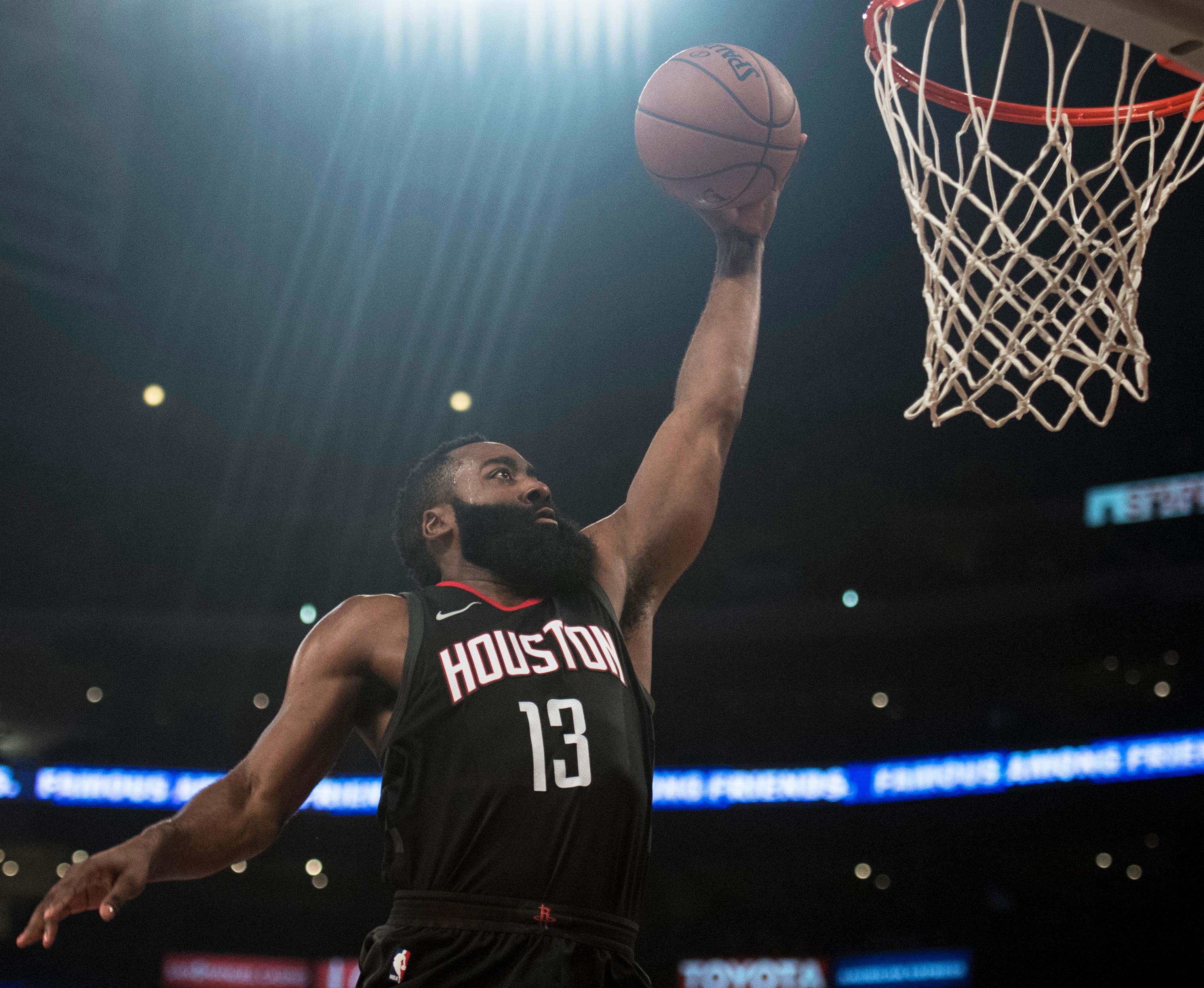 Houston Rockets guard James Harden goes up for a dunk during the first half of an NBA basketball game against the Los Angeles Lakers on Sunday, Dec. 3, 2017, in Los Angeles. (AP Photo/Kyusung Gong)