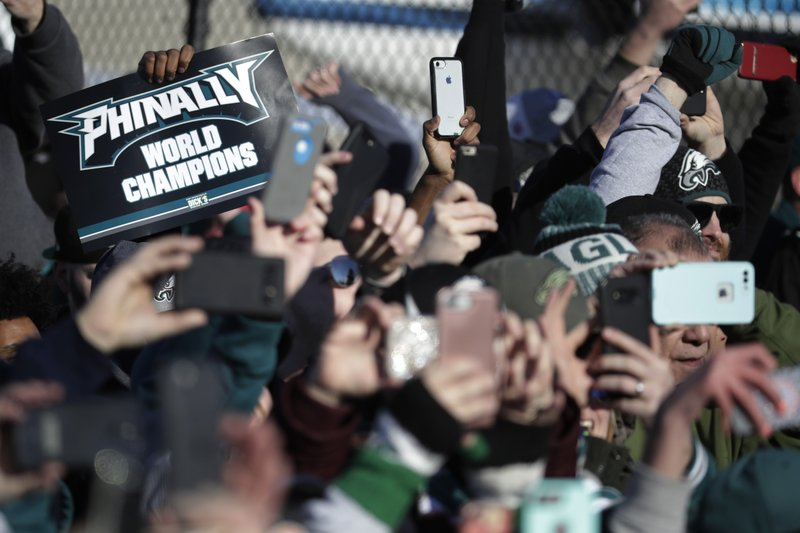 <p>Philadelphia Eagles fan hold up smartphones as the team's airplane arrives at Philadelphia International Airport a day after defeating the New England Patriots in Super Bowl 52 in Minneapolis, Monday, Feb. 5, 2018. (AP Photo/Julio Cortez)</p>