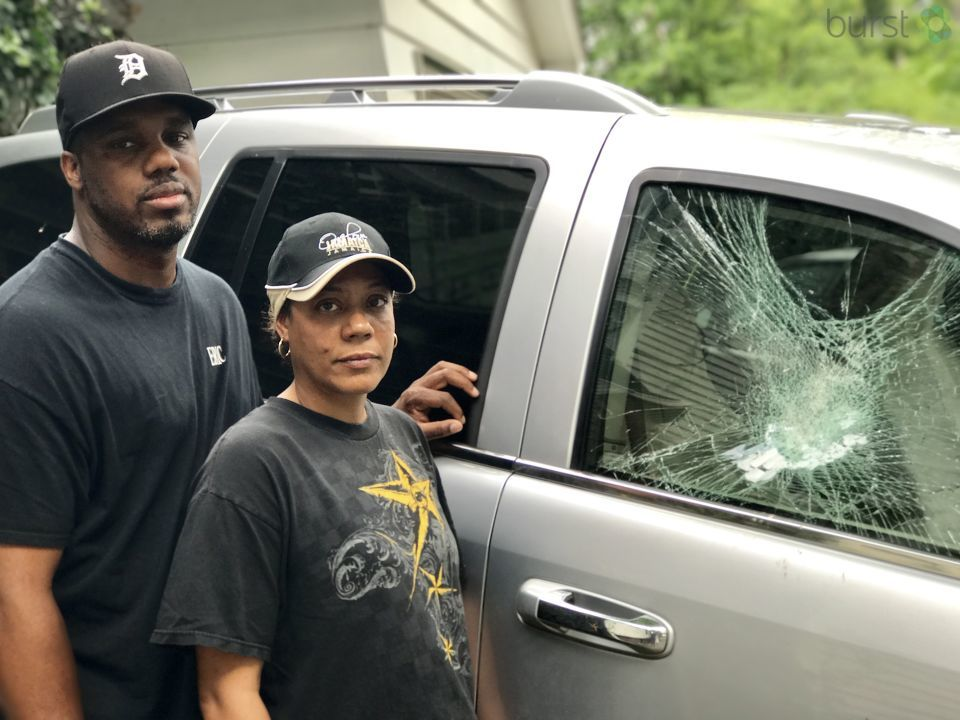 Erika Thomas and Eric Richardson look at the damage left behind from three kids, who they said, vandalized their vehicles. (Photo credit: Amanda Chodnicki)