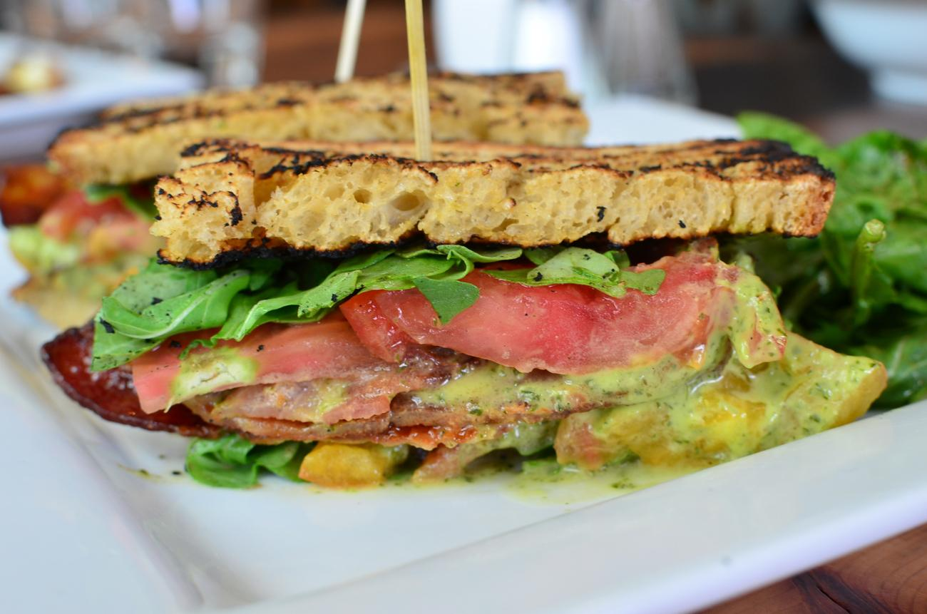 BLT: honey whole wheat, bacon, arugula tossed in house-made green goddess dressing, heirloom tomatoes, mayo / Image: Leah Zipperstein, Cincinnati Refined // Published: 6.19.17