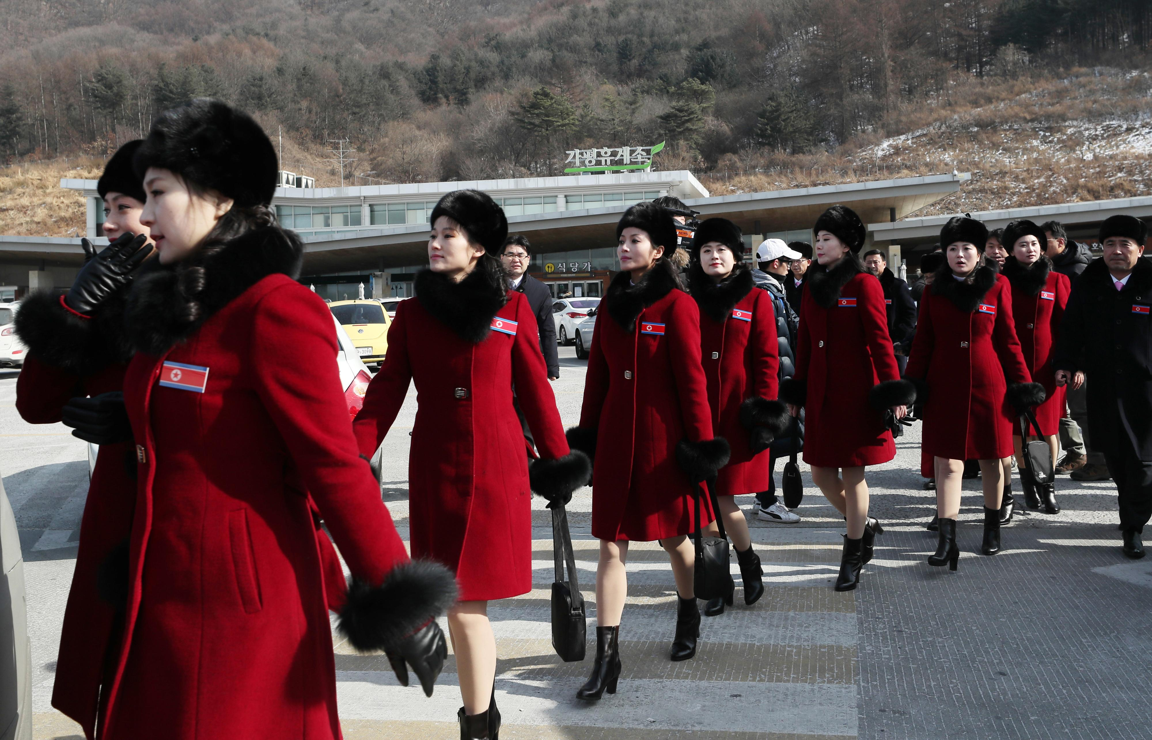 North Korean cheering squads leave an expressway service in Gapyeong, South Korea, Wednesday, Feb. 7, 2018. A North Korean delegation, including members of a state-trained cheering group, arrived in South Korea on Wednesday for the Pyeongchang Winter Olympics. (Lee Ji-eun/Yonhap via AP)