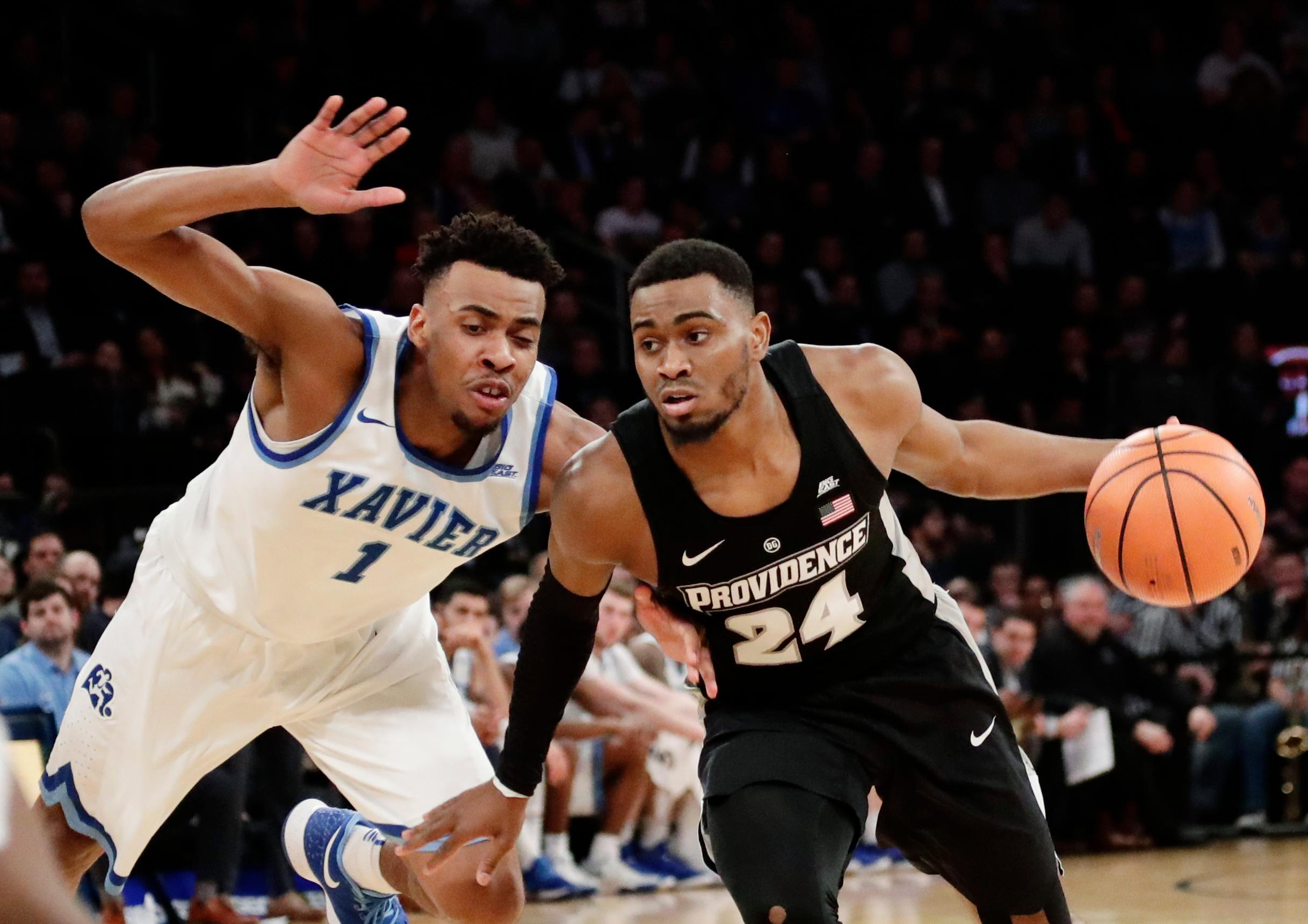 Providence's Kyron Cartwright (24) drives past Xavier's Paul Scruggs (1) during the second half of an NCAA college basketball game in the Big East men's tournament semifinals Friday, March 9, 2018, in New York. (AP Photo/Frank Franklin II)