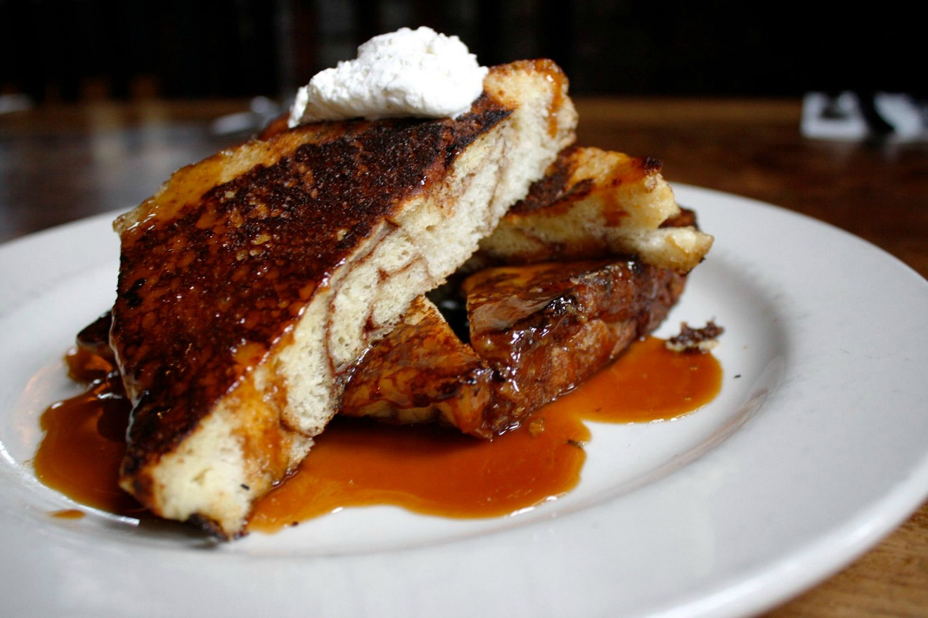 The Hi-Life. This Ballard favorite is located in a 100 year old historic firehouse and serves up their famous Monkey Bread French Toast to hungry brunchers every weekend.  At The Hi-Life they take Monkey Bread up a notch, by dipping the cinnamon-swirled pastry in vanilla custard, popping it on the griddle, and then serving it with whipped cream and caramel. (Image Courtesy: The Hi-Life Facebook page)