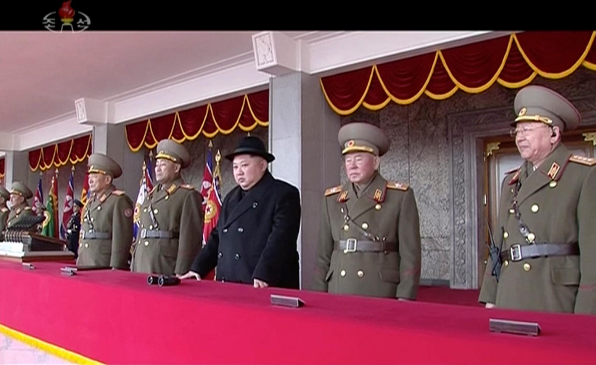 In this image made from video released by KRT on Feb. 8, 2018,  North Korean leader Kim Jong Un, center, watches the military parade in Pyongyang, Thursday, Feb. 8 2018.  North Korea held a military parade and rally on Kim Il Sung Square on Thursday, just one day before South Korea holds the opening ceremony for the Pyeongchang Winter Olympics. (KRT via AP Photo)