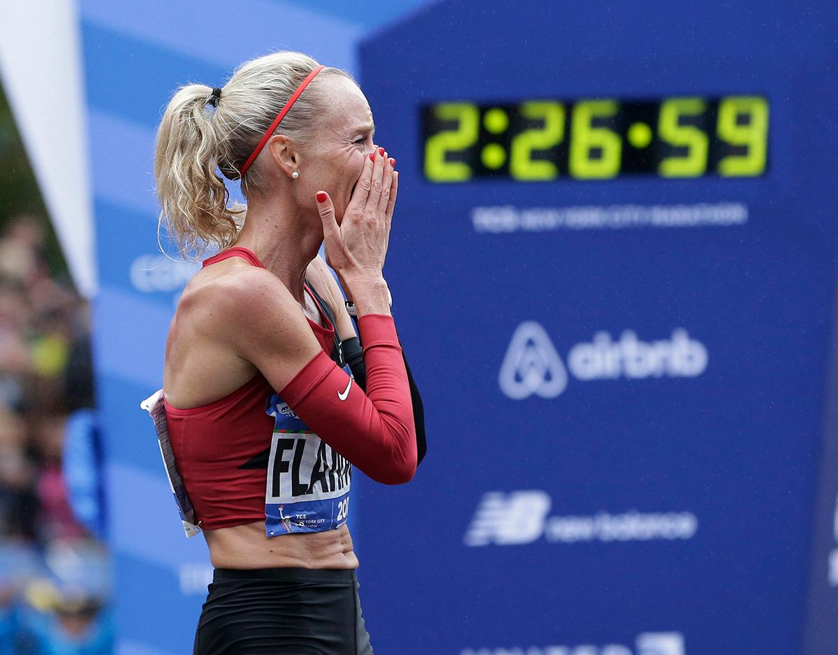 Shalane Flanagan of the United States reacts after crossing the finish line first in the women's division of the New York City Marathon in New York, Sunday, Nov. 5, 2017. (AP Photo/Seth Wenig)