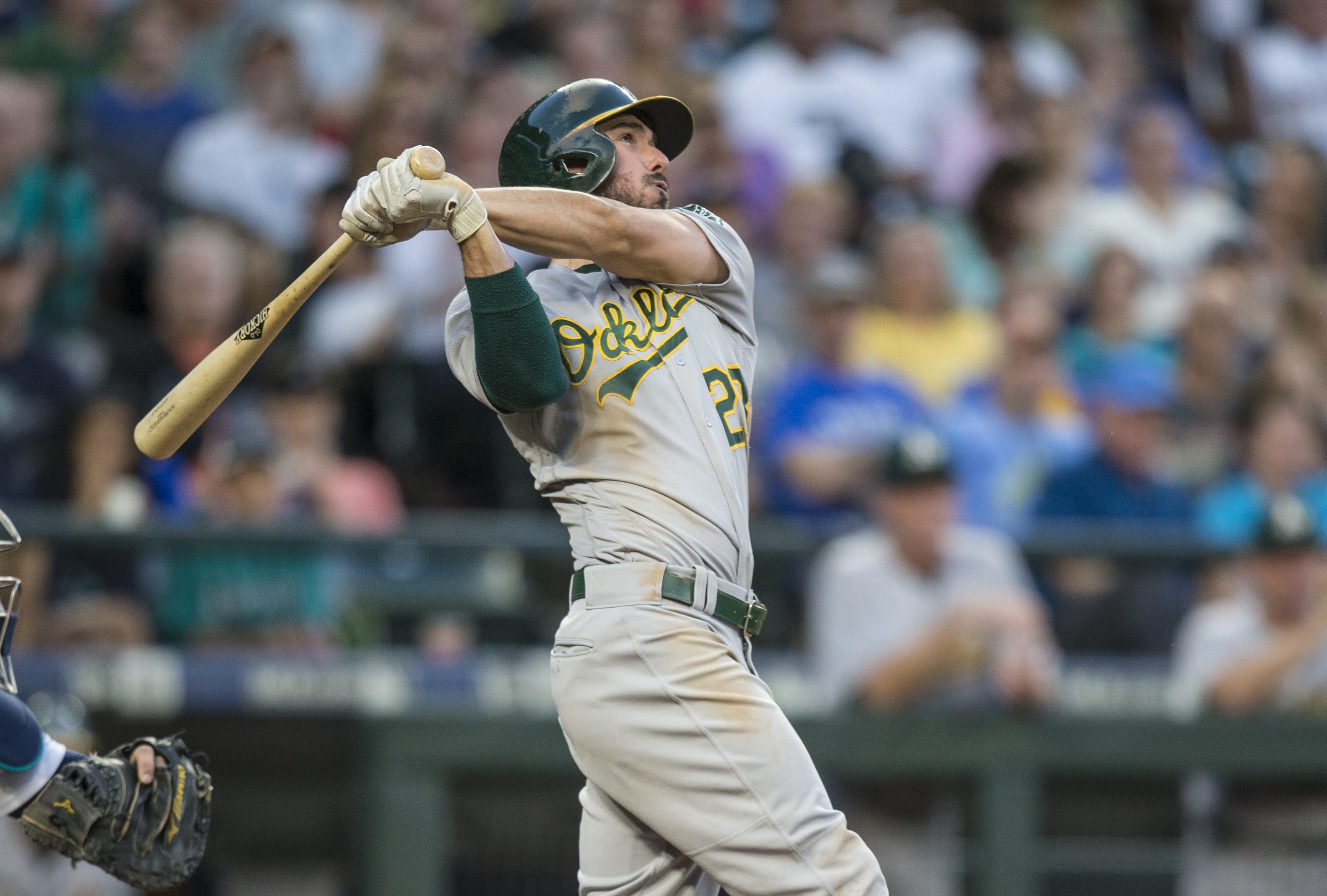 Oakland Athletics' Matt Joyce watches his three-run home run off Seattle Mariners relief pitcher Casey Lawrence during the fourth inning of a baseball game Saturday, Sept. 2, 2017, in Seattle. (AP Photo/Stephen Brashear)