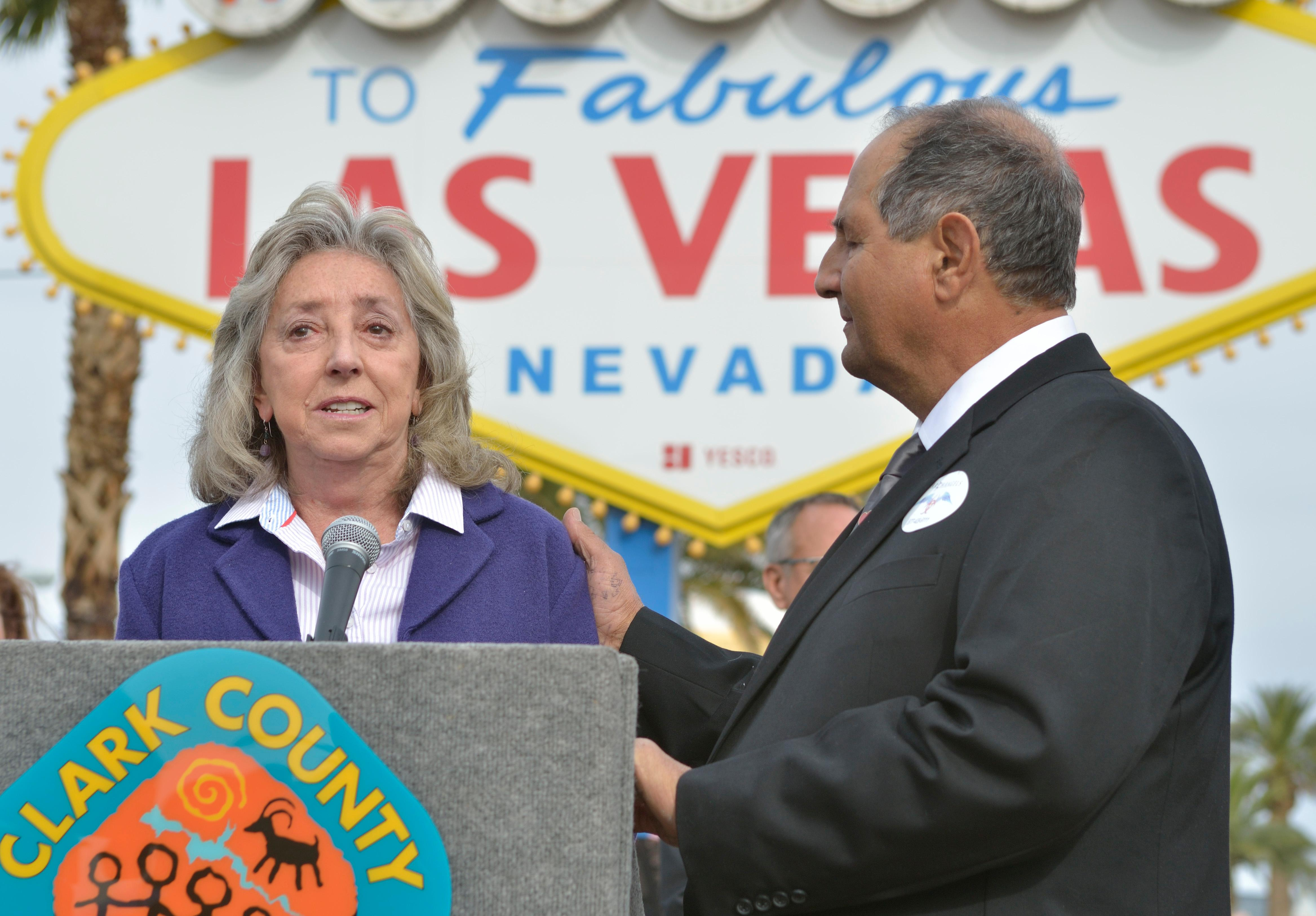 "U.S. Representative Dina Titus, D-Nev., left, speaks as Greg Zanis listens during ""Greg Zanis Day"" at the Welcome to Fabulous Las Vegas sign on the Las Vegas Strip on Sunday, Nov. 12, 2017. Zanis, a carpenter from Aurora, Ill., was recognized by the Clark County Commision for creating 58 crosses memorializing those who died during the Route 91 Harvest festival shooting on Oct. 1. The crosses were later moved to the Clark County Museum for its permanent collection. [Bill Hughes/Las Vegas News Bureau]"