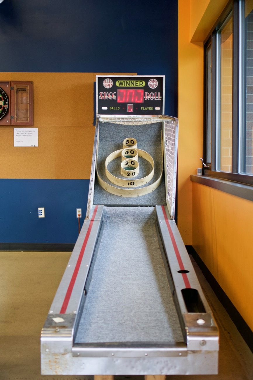 The tap room's atmosphere is very friendly and approachable. There is plenty of seating and games to go along with it, including corn hole, air hockey, Skee-Ball, oversized Jenga, and an array of board games. It's the perfect stop for evenings after work—or mid-day during work. It's also for weekends with family and friends. / Image: Brian Planalp // Published: 1.7.19