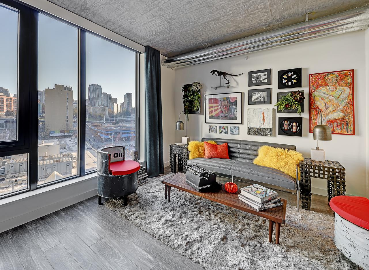 The living area in a one bedroom apartment at AMLI Arc