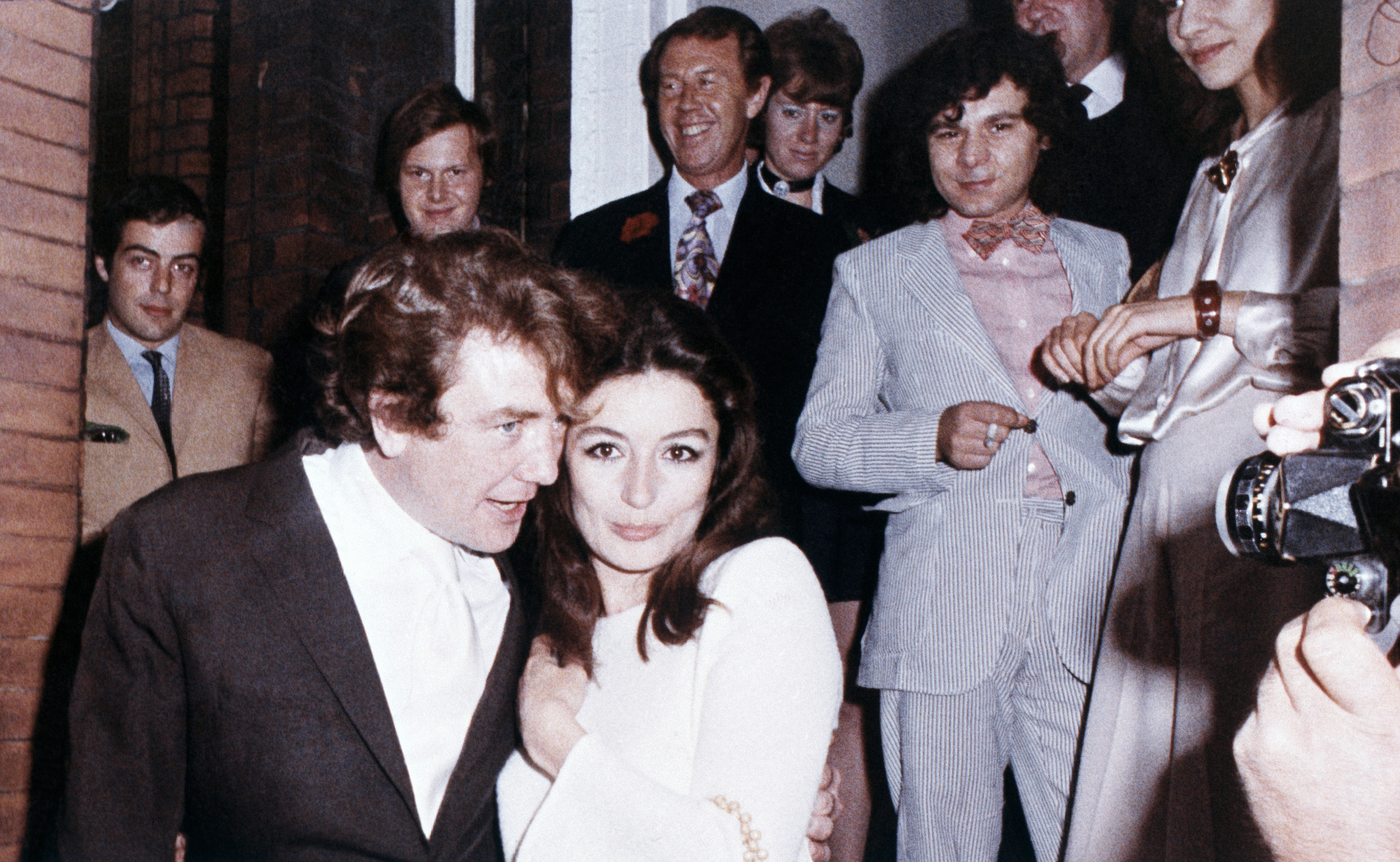 "FILE  - In this 1970 file photo, British actor Albert Finney embraces his bride, French Actress Anouk Aimee, after their registry office wedding in London. Finney, the Academy Award-nominated star of films from ""Tom Jones"" to ""Skyfall"" has died at the age of 82 it was reported on Friday, Feb. 8, 2019. (AP Photo/Eddie Worth, File)"