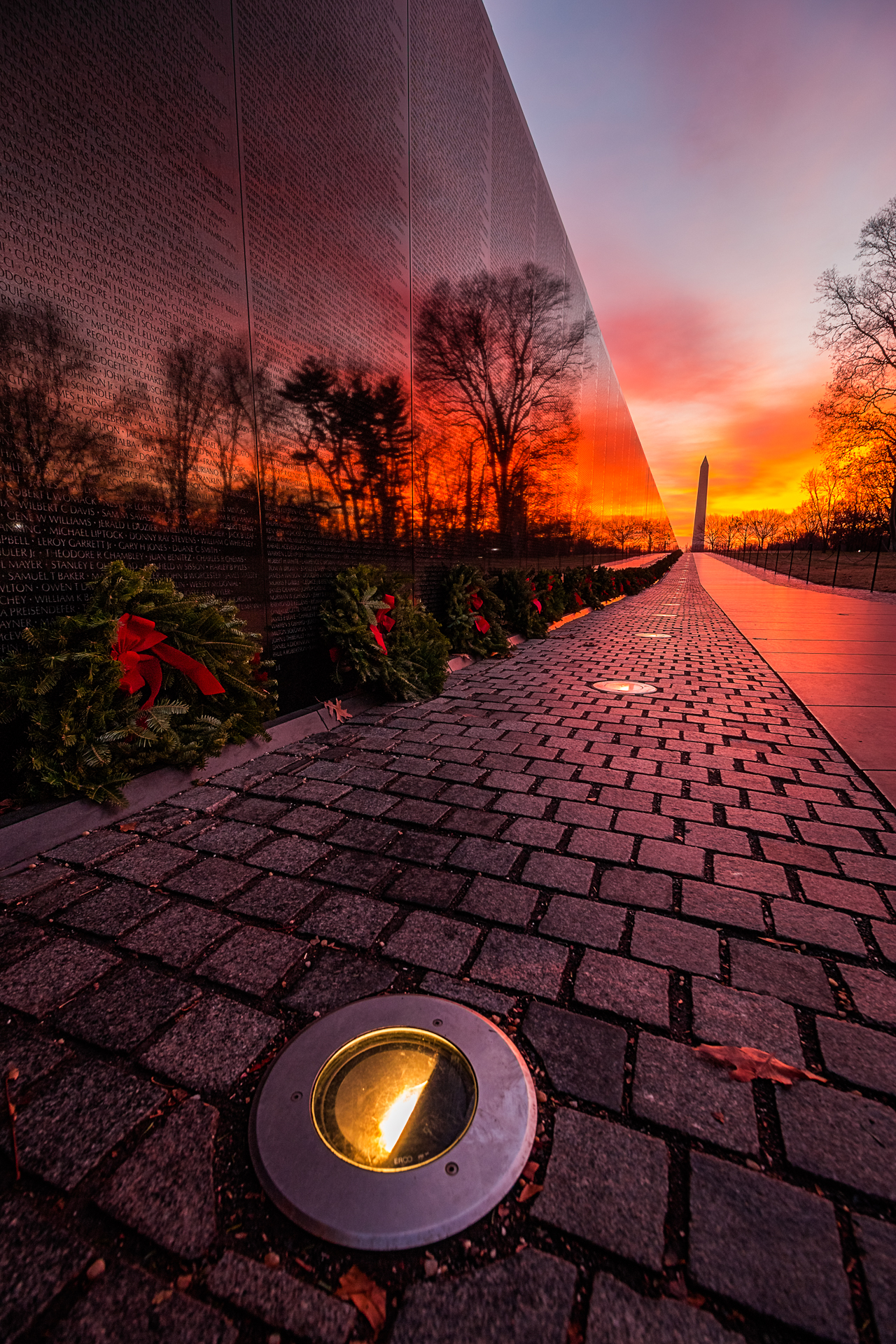 Honoring Those Lost – A bright red sunrise at the Vietnam Veterans Memorial{&amp;nbsp;}(Image: Zack Lewkowicz)<p></p>