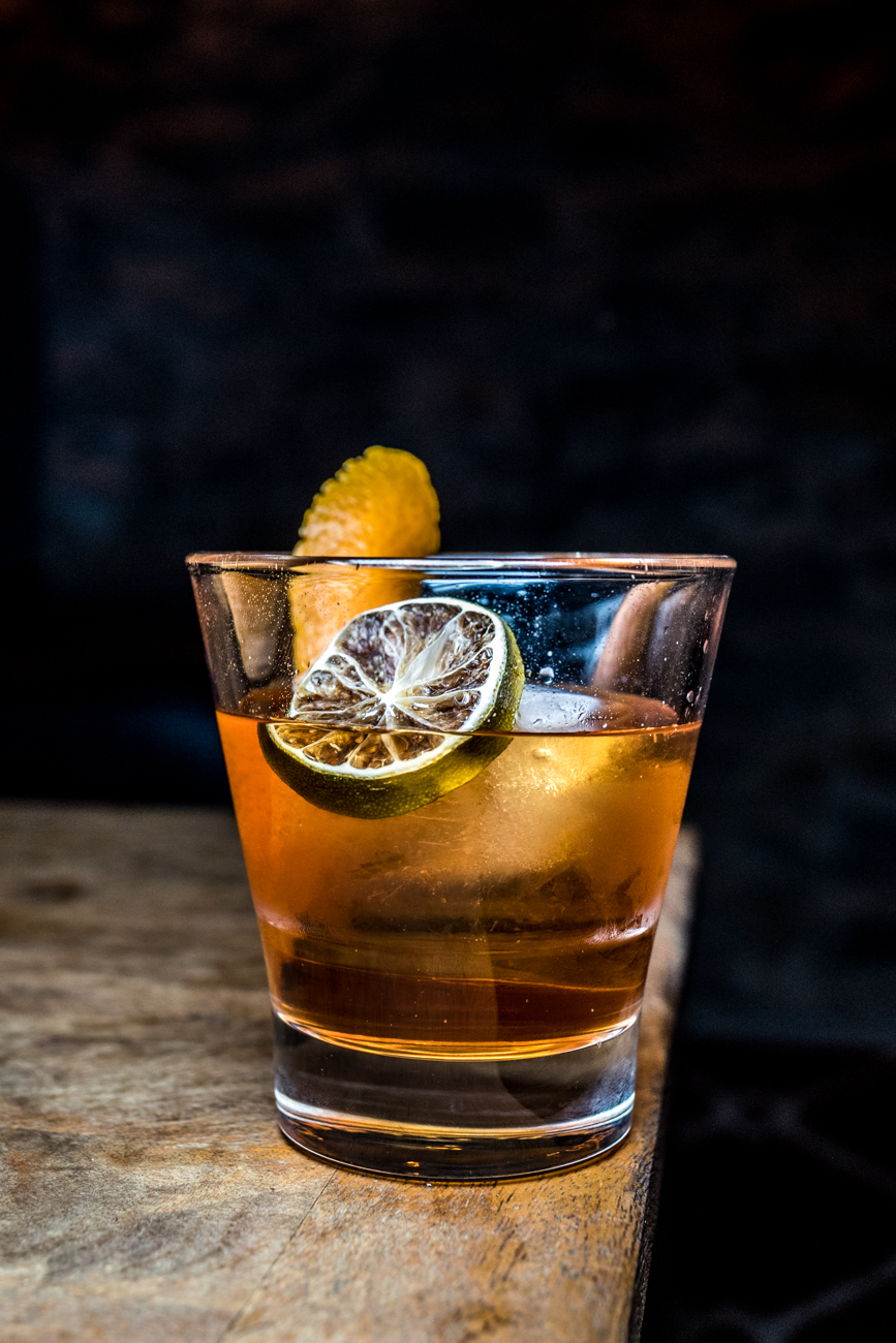 Rum Old Fashioned: Plantation Pineapple and 5 Years Rum, Angostura bitters, and simple syrup garnished with an orange peel and a dehydrated lime slice / Image: Catherine Viox // Published: 3.3.20