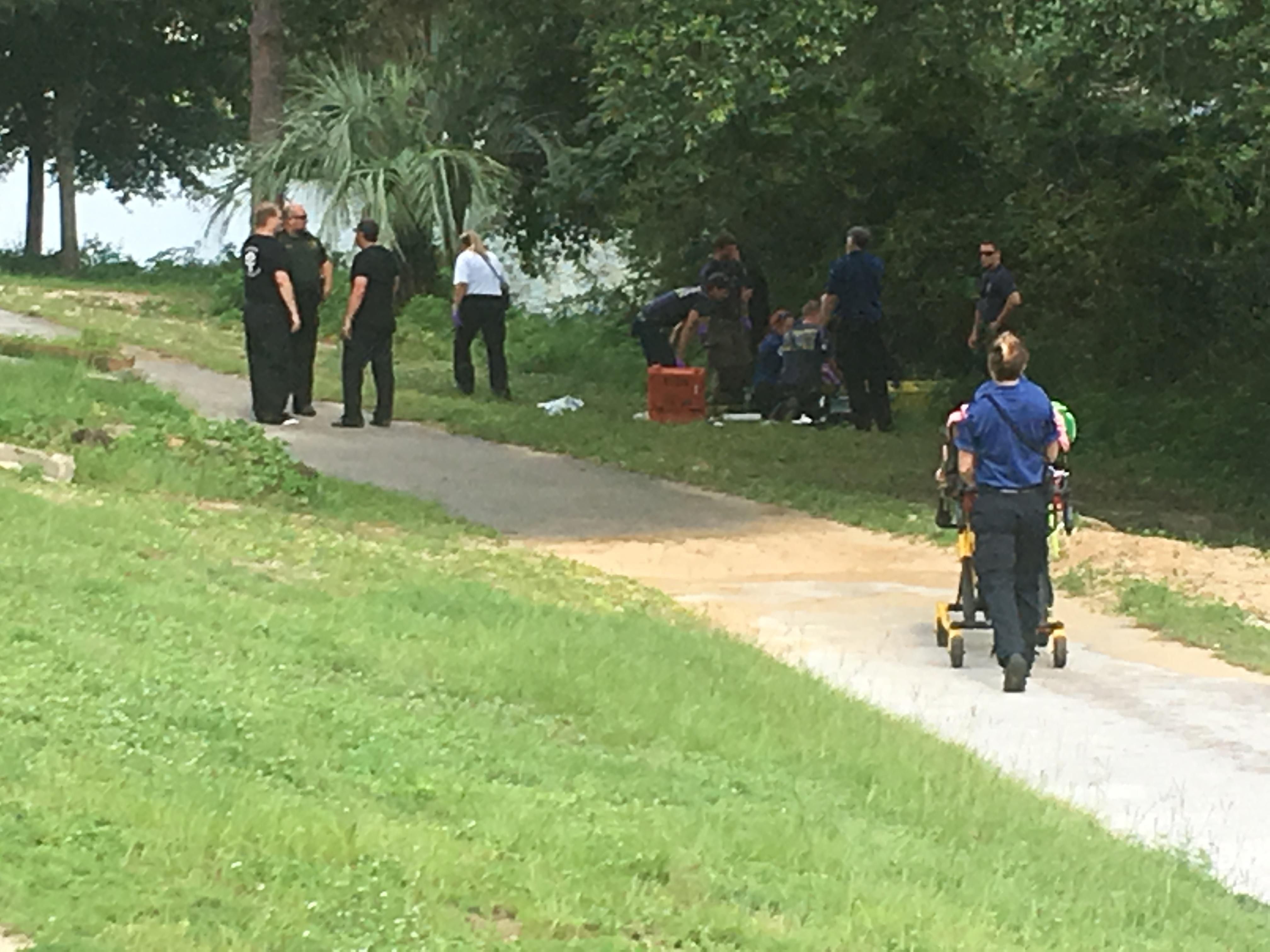 One adult, one child hospitalized after vehicle drives into water
