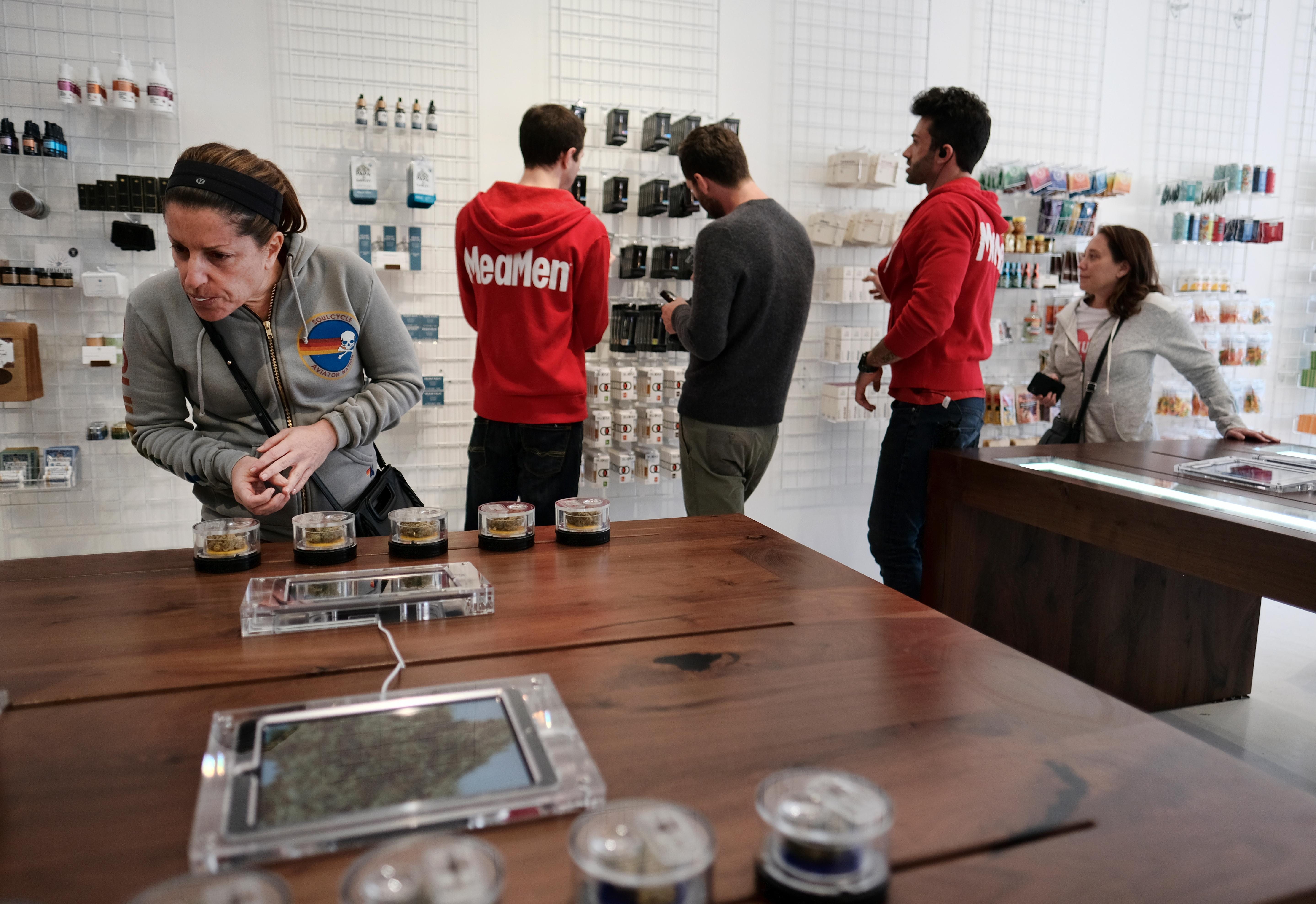 In this Thursday, Dec. 21, 2017 photo a customer browses a selection of marijuana products displayed at MedMen a medical marijuana dispensary in Los Angeles . California kicks off recreational sales for adults on New Year's Day, but Los Angeles officials say dispensaries in the city won't be part of the celebration. The city announced Friday, Dec. 22, 2017, that it won't begin accepting applications to sell legal recreational pot until Jan. 3. It could take a month or more before those businesses are properly licensed with the city and state. (AP Photo/Richard Vogel)