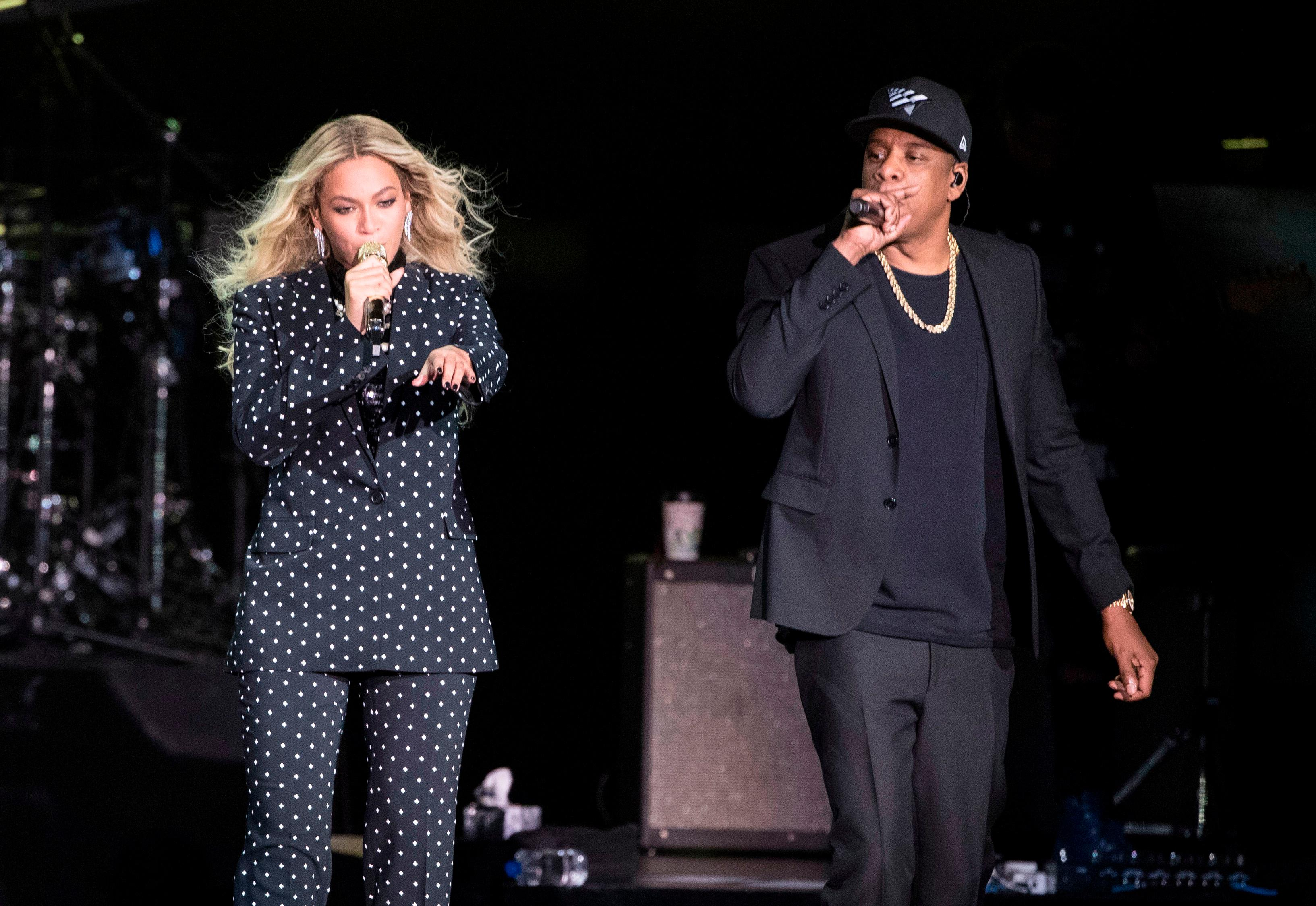 FILE - In this Nov. 4, 2016 file photo, Beyonce and Jay-Z perform during a Democratic presidential candidate Hillary Clinton campaign rally in Cleveland.(AP Photo/Matt Rourke, File)
