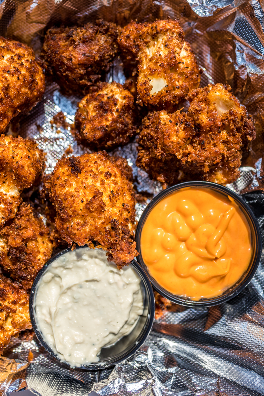 Vegan Cauliflower Wings: battered in PBR, Panko, and a five-spice rub / Image: Catherine Viox // Published: 5.2.20