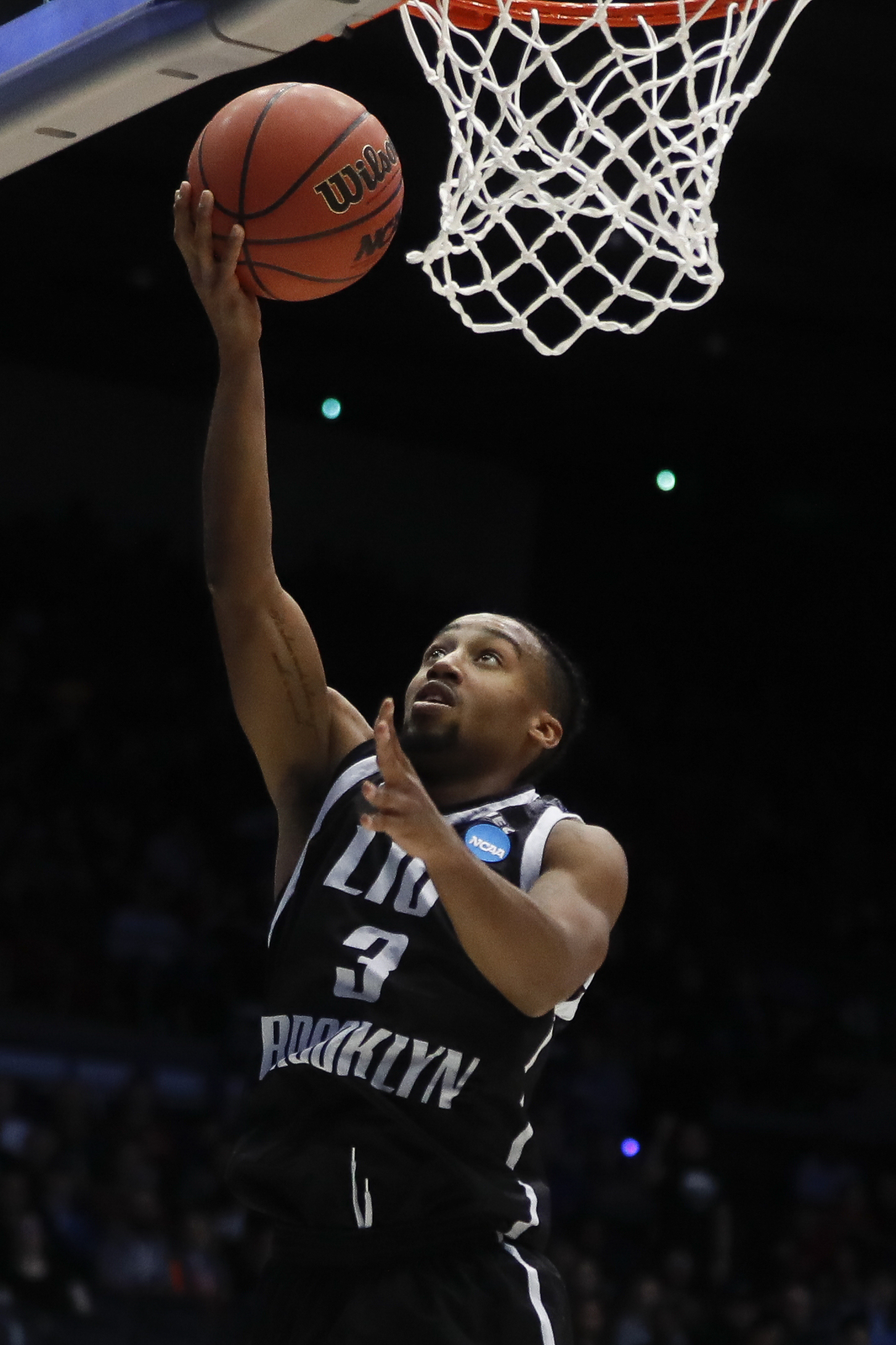 LIU Brooklyn's Jashaun Agosto shoots during the first half of a First Four game of the NCAA men's college basketball tournament against Radford, Tuesday, March 13, 2018, in Dayton, Ohio. (AP Photo/John Minchillo)