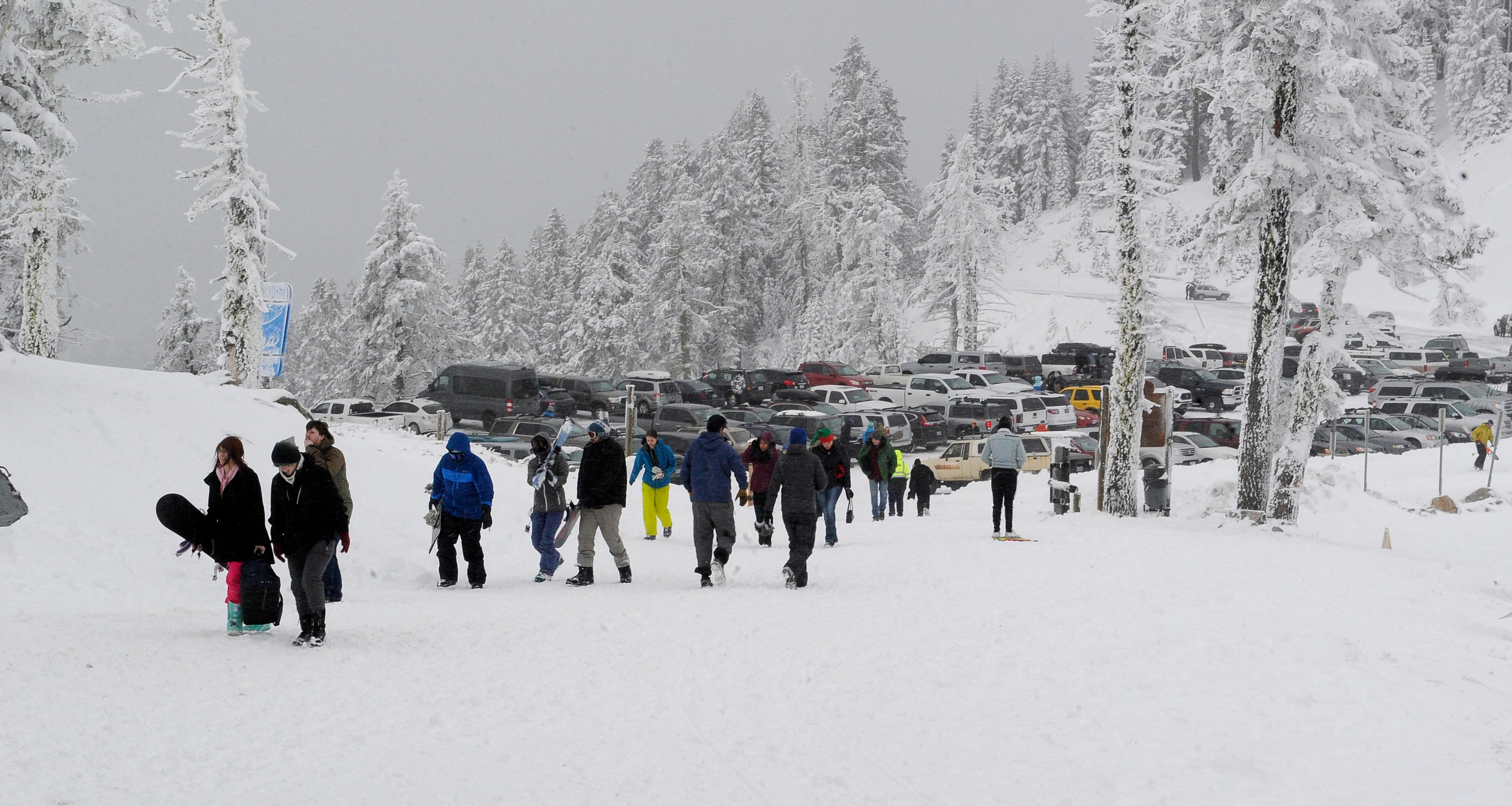 Andy Atkinson / Mail Tribune <p>The parking lot was full Saturday afternoon for Mt. Ashland's Snow Stomp party.</p>