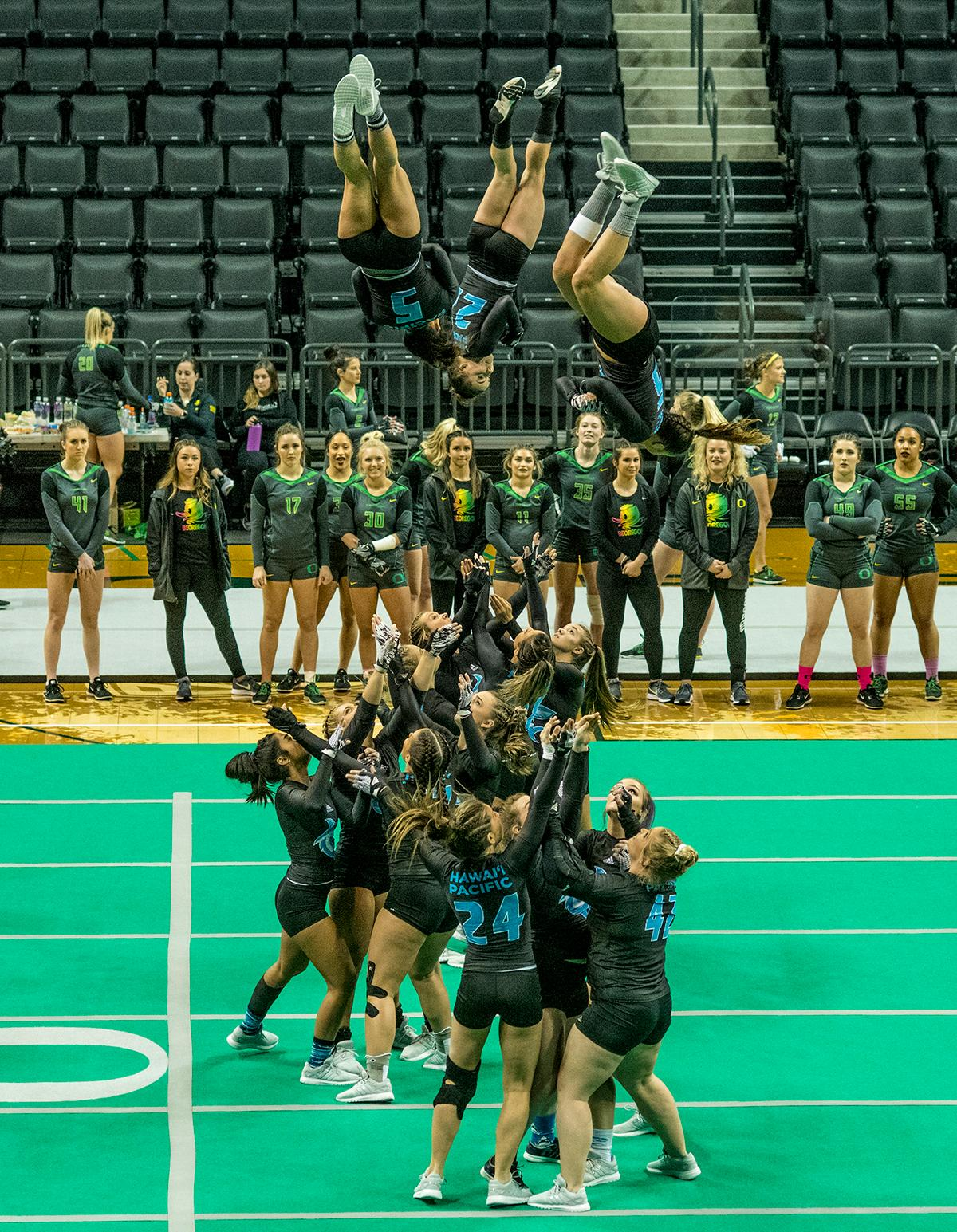 The Oregon Ducks Acro and Tumbling team defeated Hawaii Pacific in their second meet of the season and their first home meet with a score of 280.10 to 267.595. The Ducks won all six categories: 38.45 to 38.30 in compulsory; 29.55 to 28.55 in acro; 29.50 to 28.40 in pyramid; 29.10 to 27.50 in toss; 56.30 to 54.075 in tumbling; and 97.20 to 90.77 in team. The Ducks next face off against their arch rivals the Baylor Bears at Baylor February 24 and then return to Matt Knight Arena for a Tri Meet against Quinnipac and Gannon on March 11. Photo by Dan Morrison, Oregon News Lab