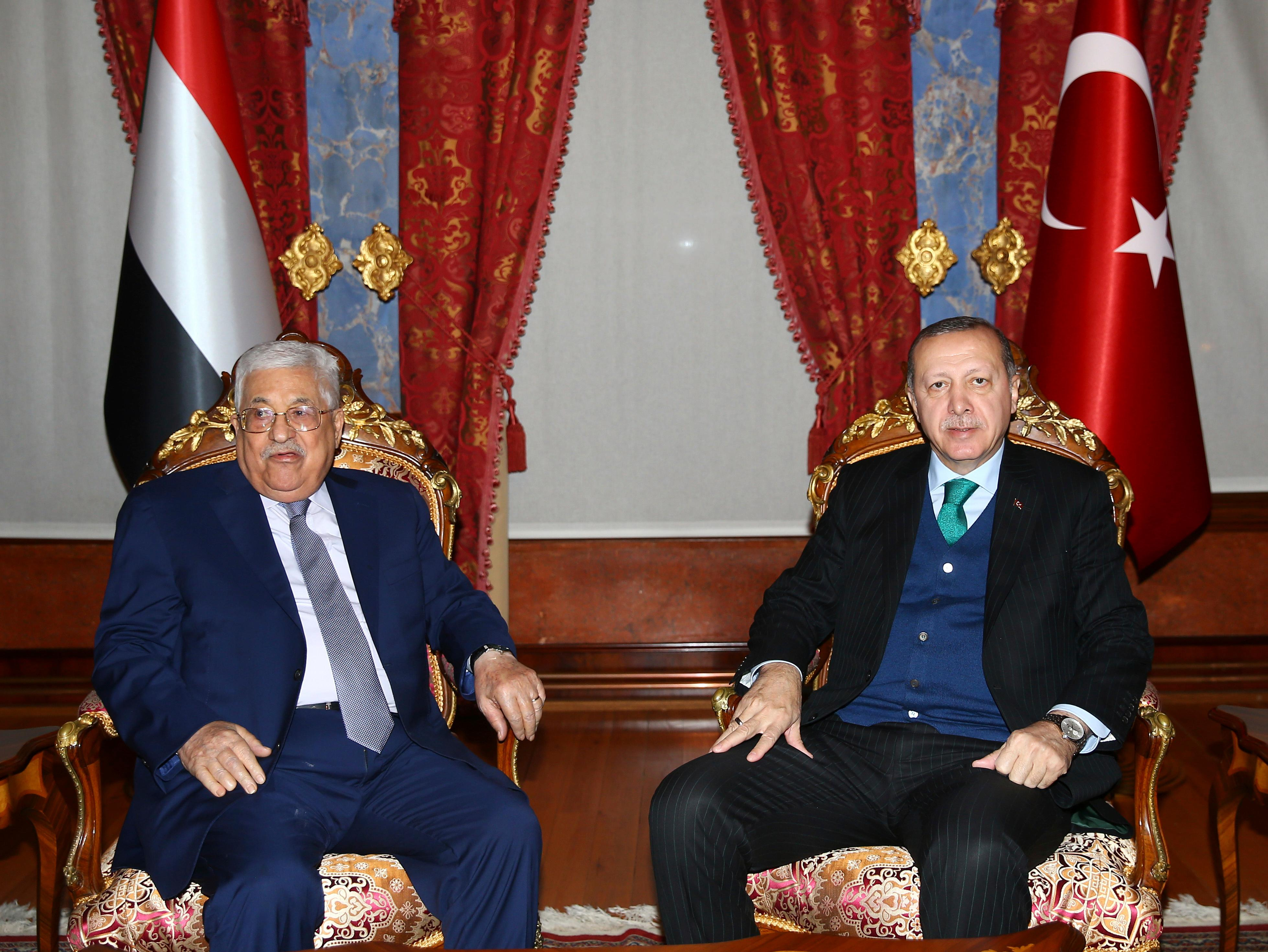"Turkey's President Recep Tayyip Erdogan, right, meets with Palestinian President Mahmoud Abbas, left, in Istanbul, Tuesday, Dec. 12, 2017. Leaders and high-ranking officials of Muslim countries will meet Wednesday Dec. 13, in Istanbul for an extraordinary summit to discuss the U.S. recognition of Jerusalem as Israel's capital. Erdogan has been vehemently critical of the U.S. move and said the leaders would relay a ""strong message."" (Kayhan Ozer/Pool Photo via AP)"