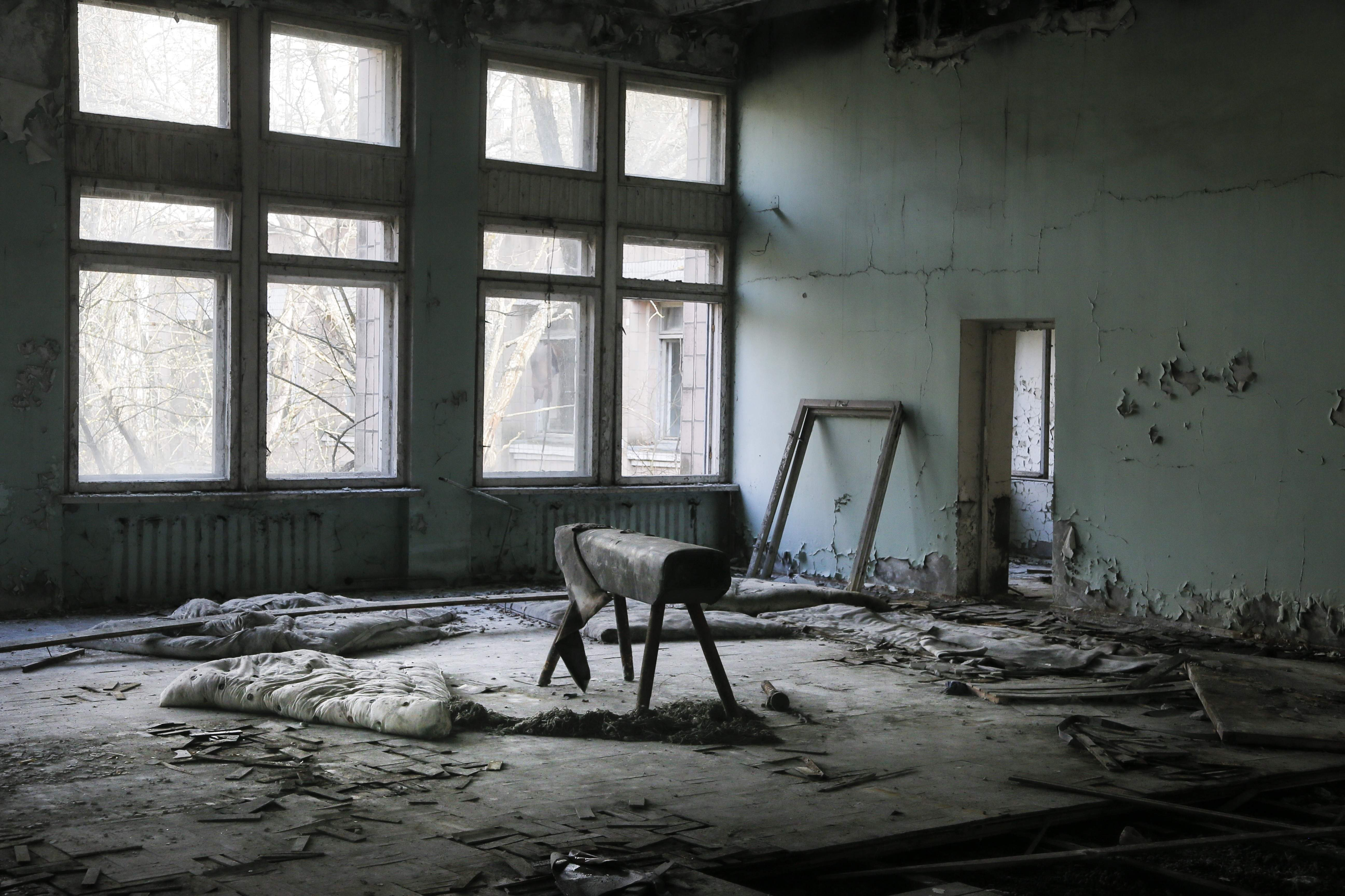 This photo taken Wednesday, April 5, 2017, shows a gymnasium in a school in the deserted town of Pripyat, some 3 kilometers (1.86 miles) from the Chernobyl nuclear power plant Ukraine. Once home to some 50,000 people whose lives were connected to the Chernobyl nuclear power plant, Pripyat was hastily evacuated one day after a reactor at the plant 3 kilometers (2 miles away) exploded on April 26, 1986. The explosion and the subsequent fire spewed a radioactive plume over much of northern Europe. THE ASSOCIATED PRESS