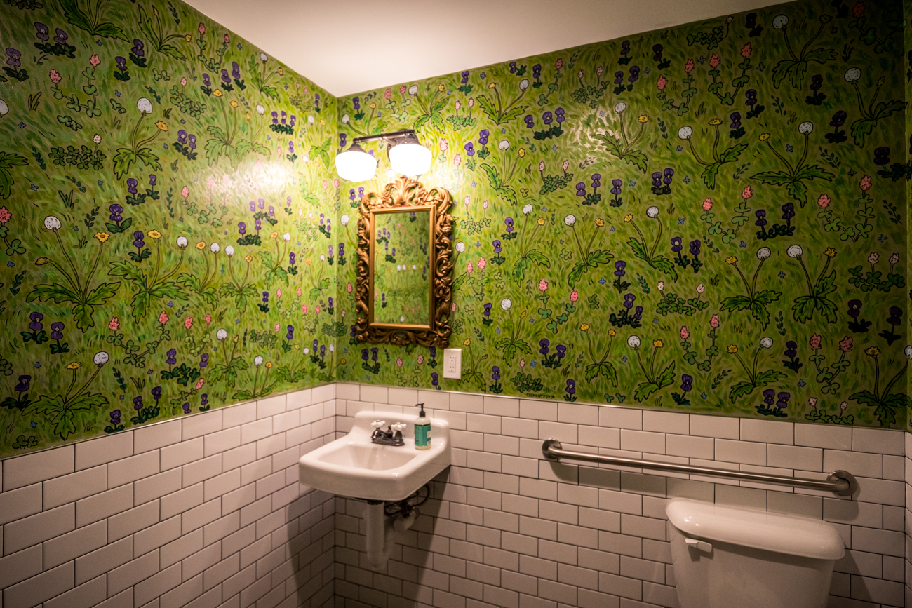A lot of the interior work was done by friends and family of the Barraco brothers, including the custom tables and benches. The hand-painted wallpapers in the restrooms were done by Chris Clements. / Image: Catherine Viox // Published: 7.3.20